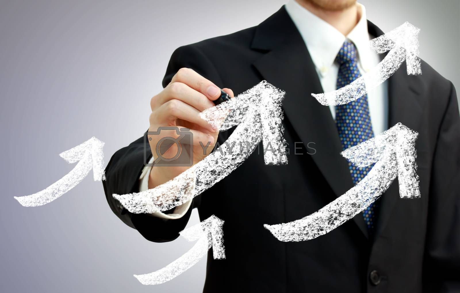 Royalty free image of Businessman with Rising Arrows Representing Growth by melpomene