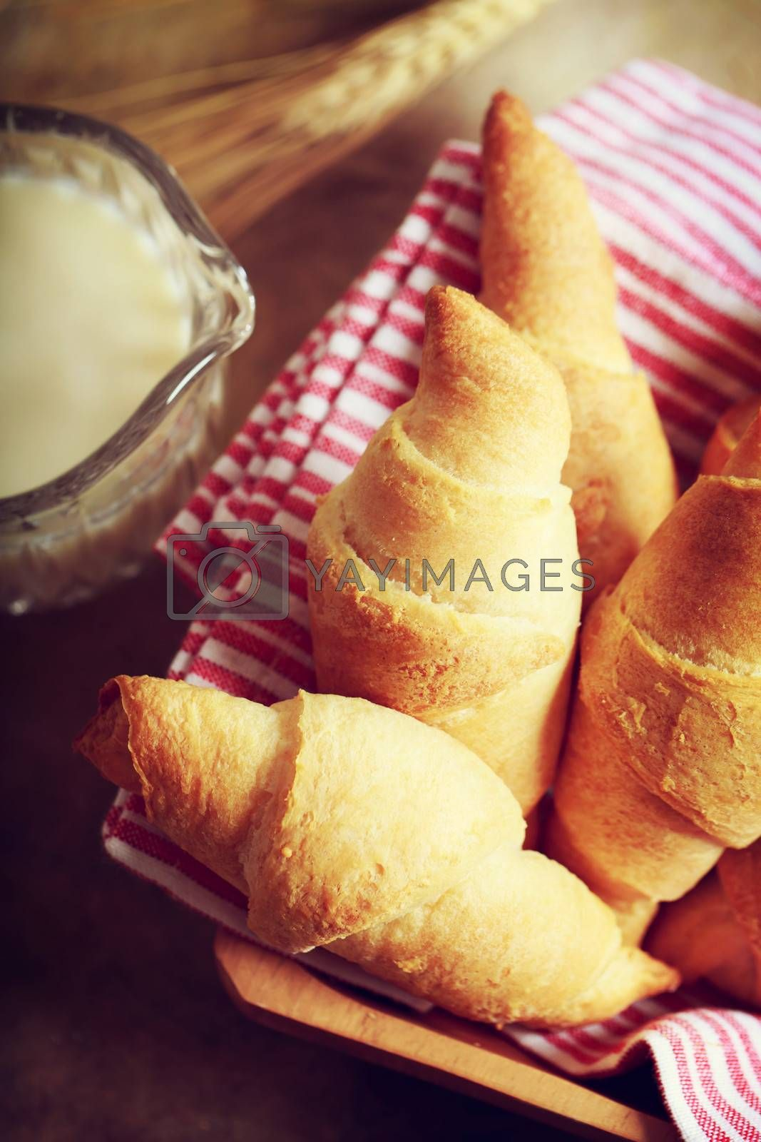 Royalty free image of Croissant with milk and wheat by melpomene