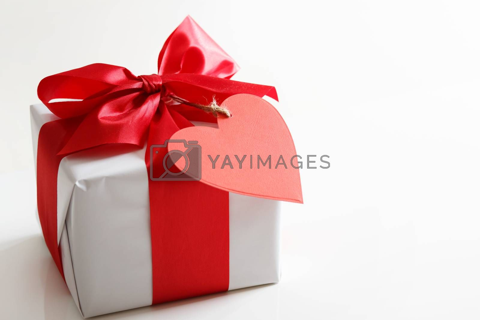 Royalty free image of Gift box with red heart tag by melpomene