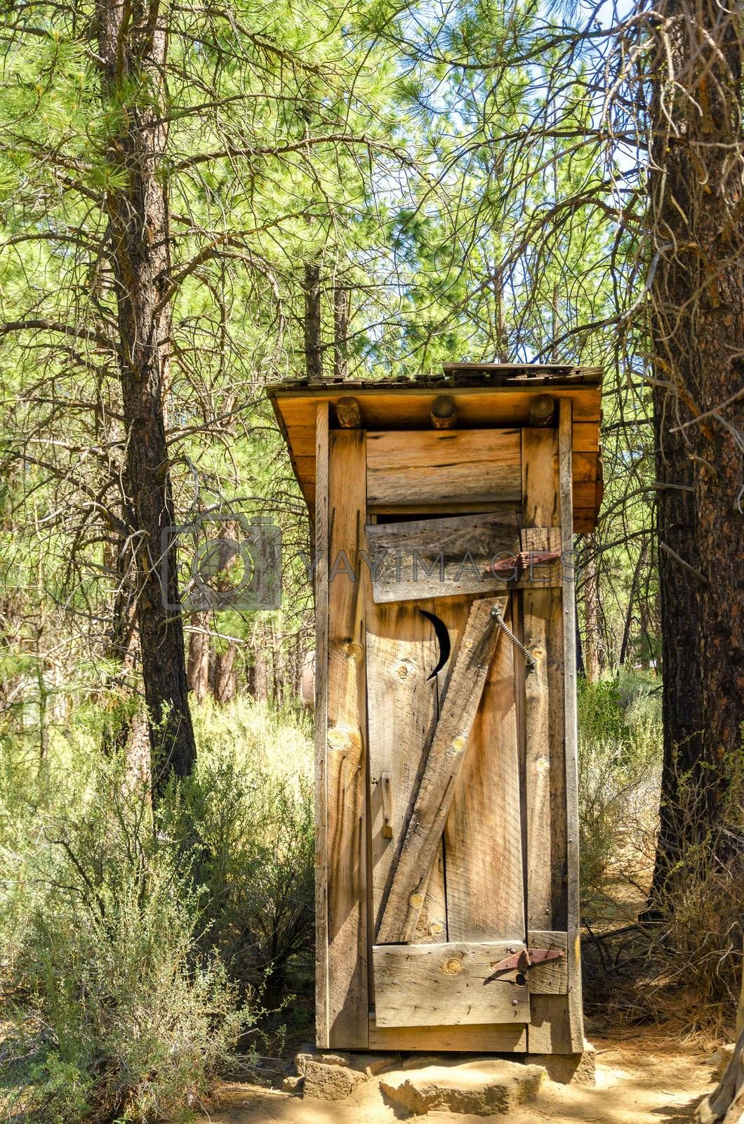 Old wooden historic outhouse in Bend, Oregon