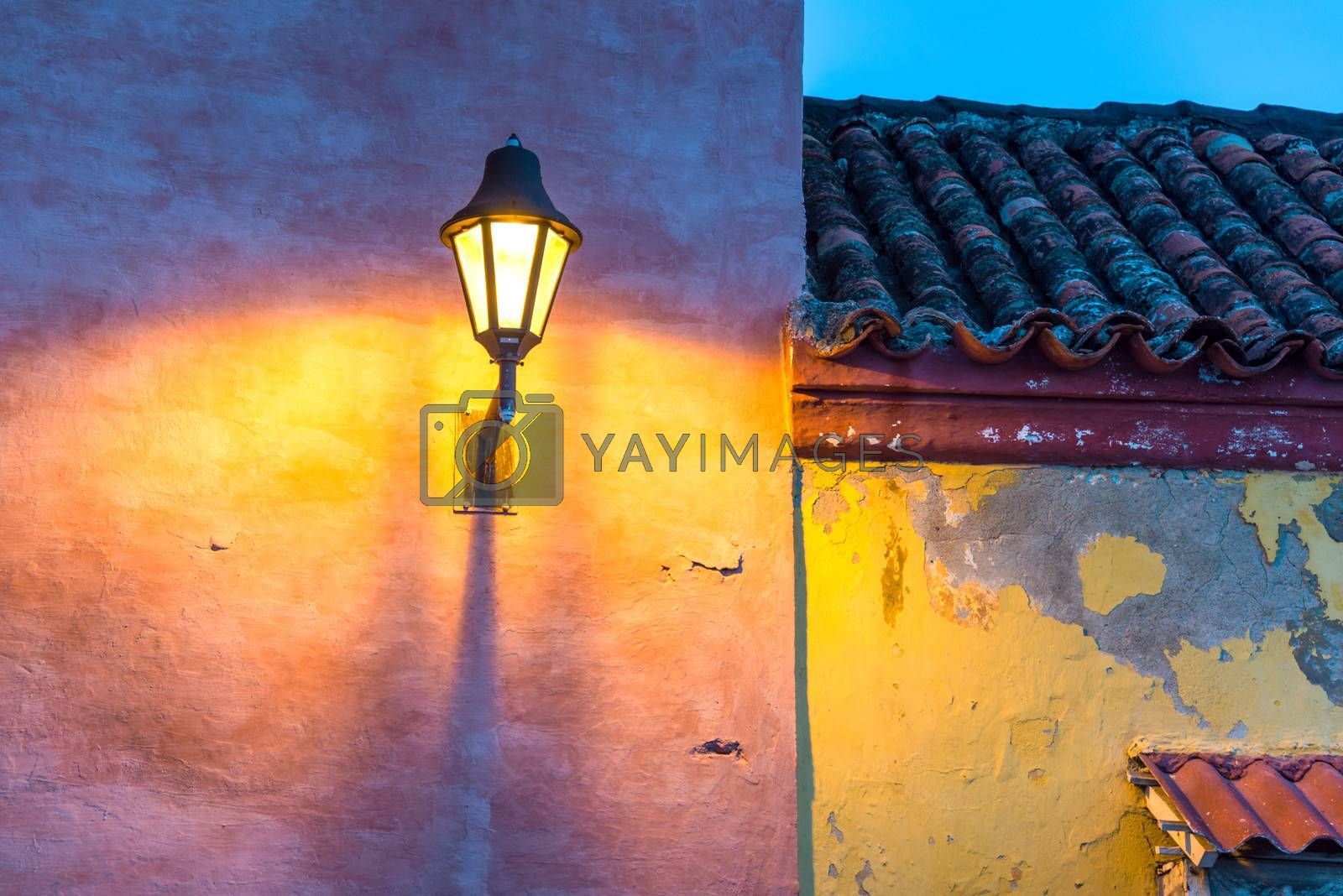 Old colonial buildings and a streetlight at night in the old town of Cartagena, Colombia