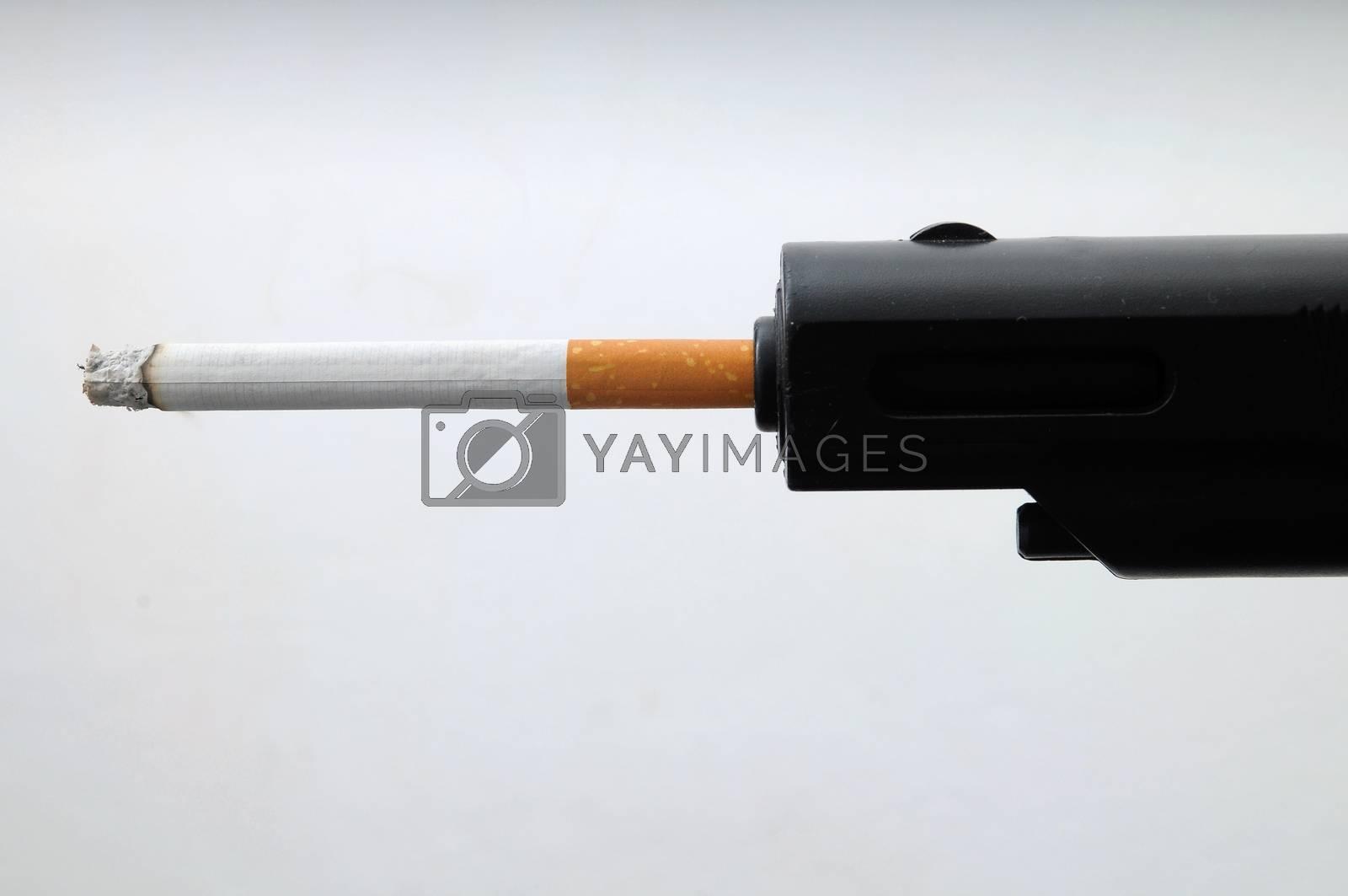Black Gun Shooting Cigarette on a White Background