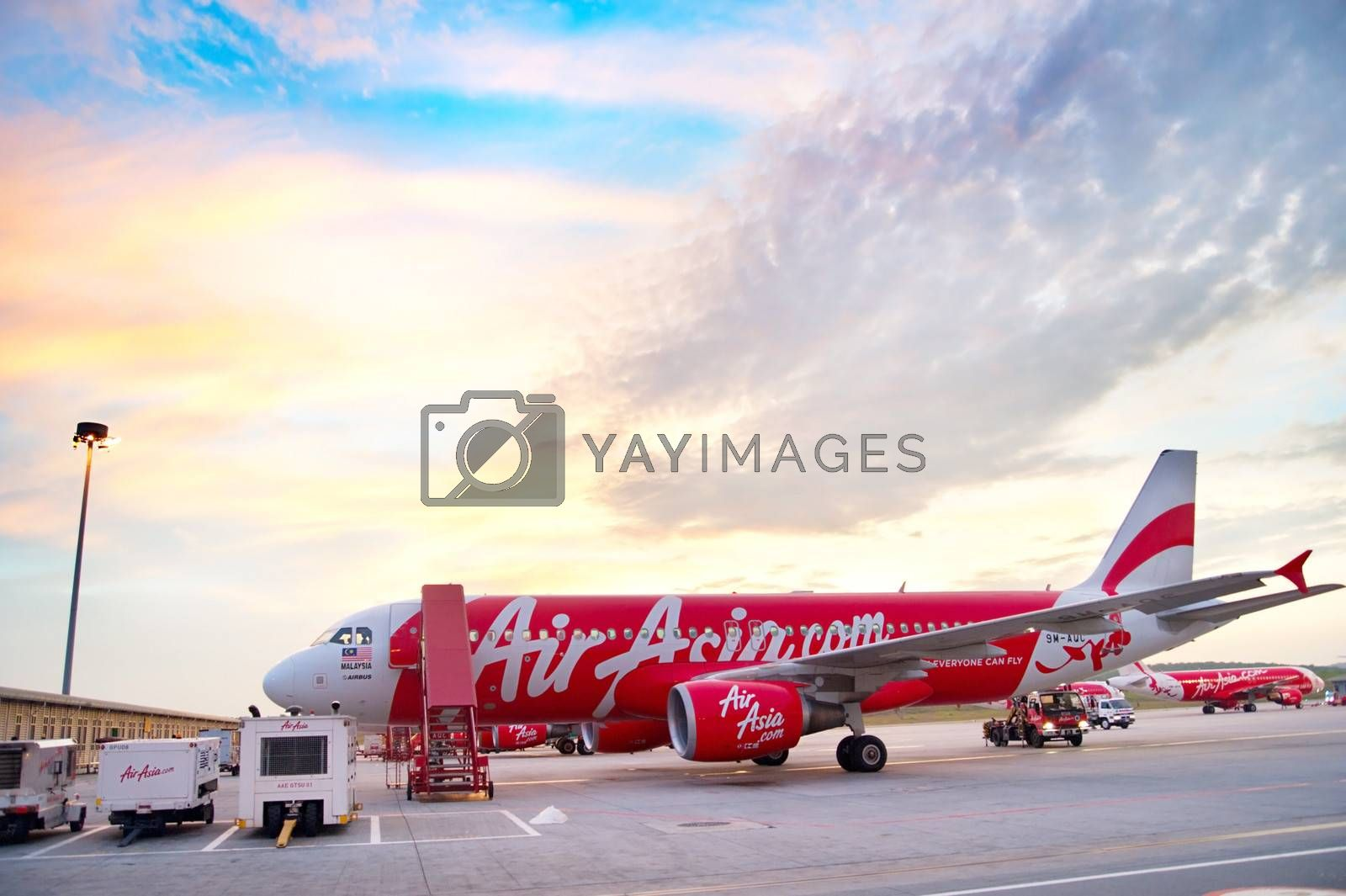 Kuala Lumpur, Malaysia - May 14, 2013: AirAsia Jet airplane in Kuala Lumpur airport in Kuala Lumpur. Its been named as world's best low-cost airline, operates scheduled flights to 78 destinations
