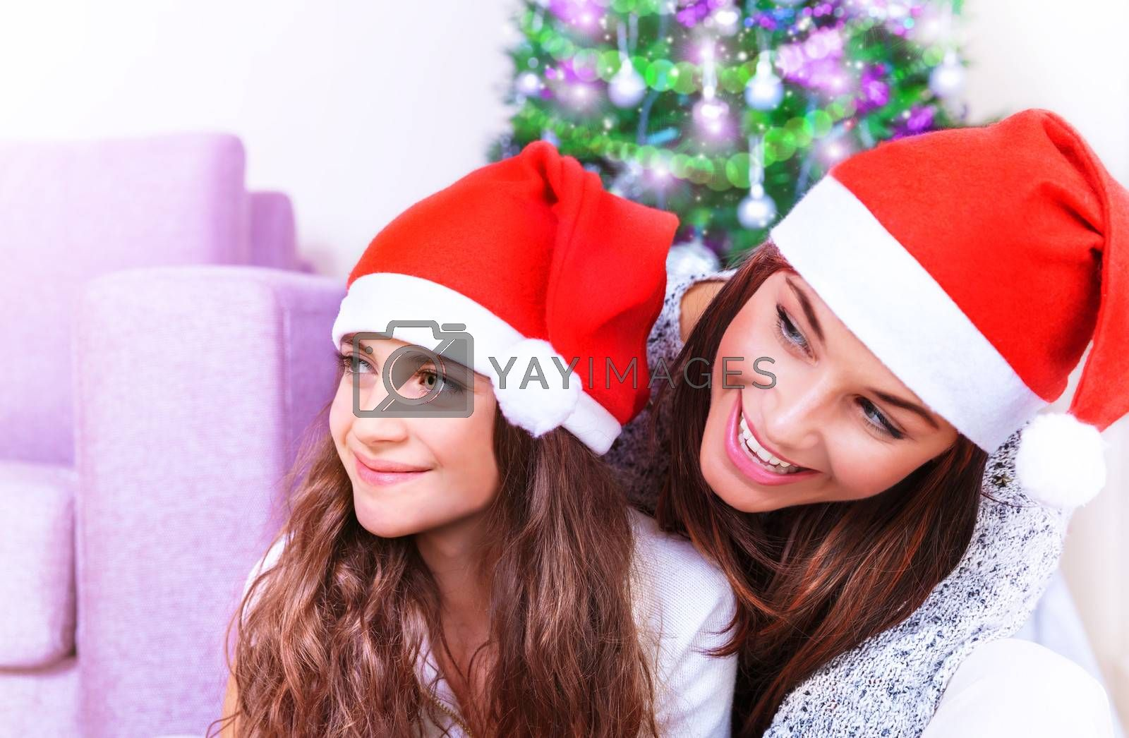Closeup portrait of cute mother with cheerful daughter celebrate Christmas holiday at home, happy family party, winter vacation concept