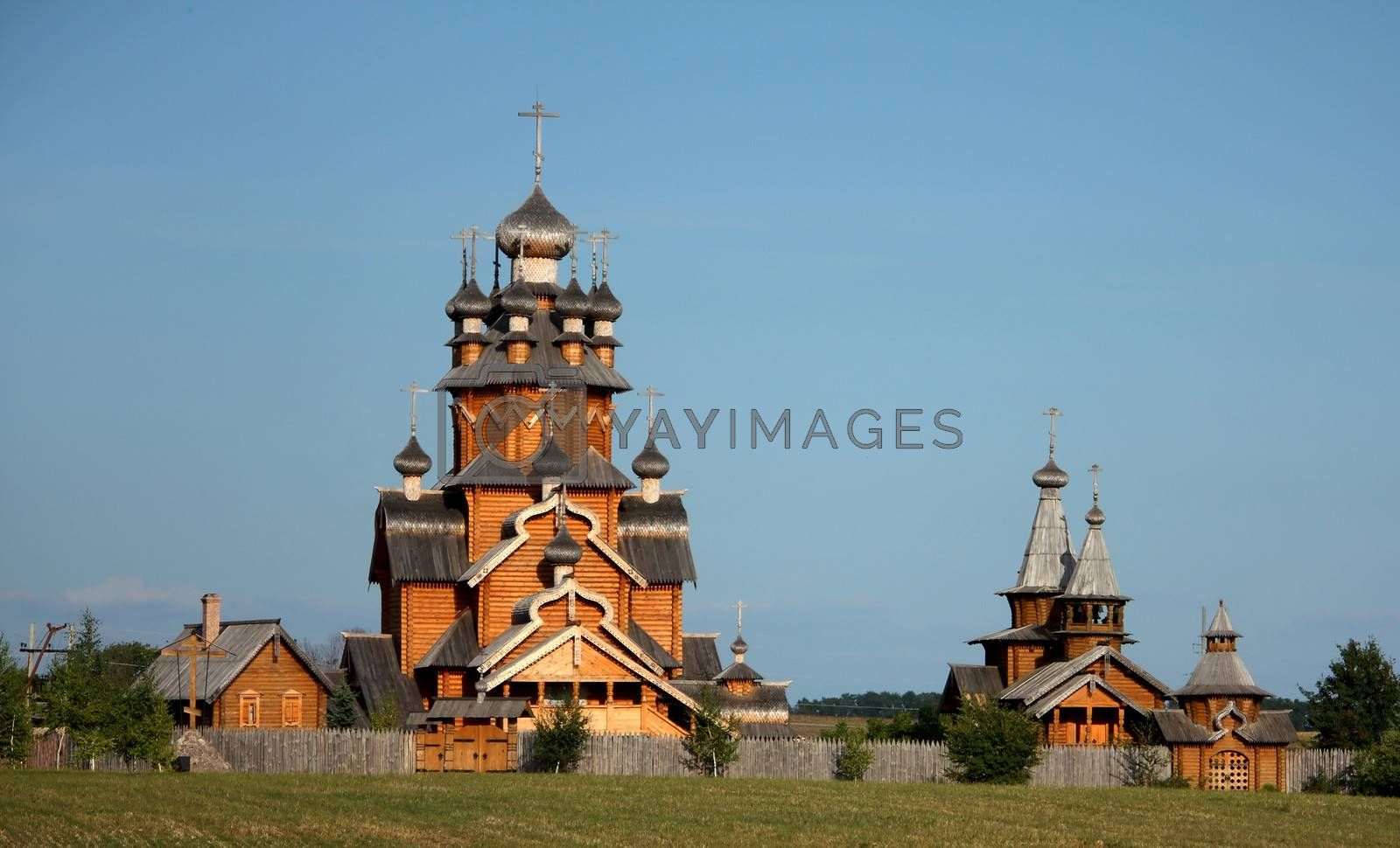 Village with traditional wooden houses and church