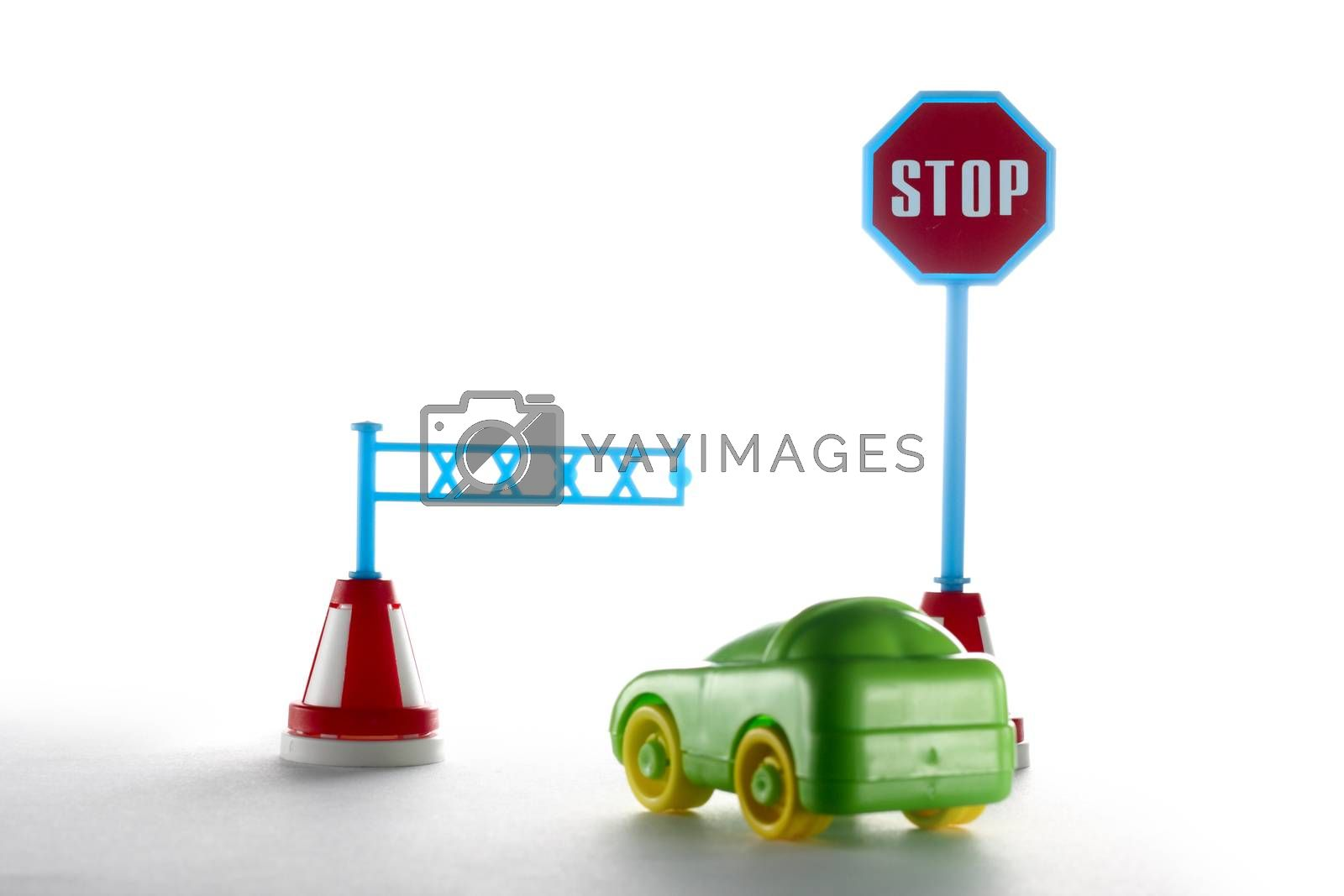 Car behind barrier with sign on white background