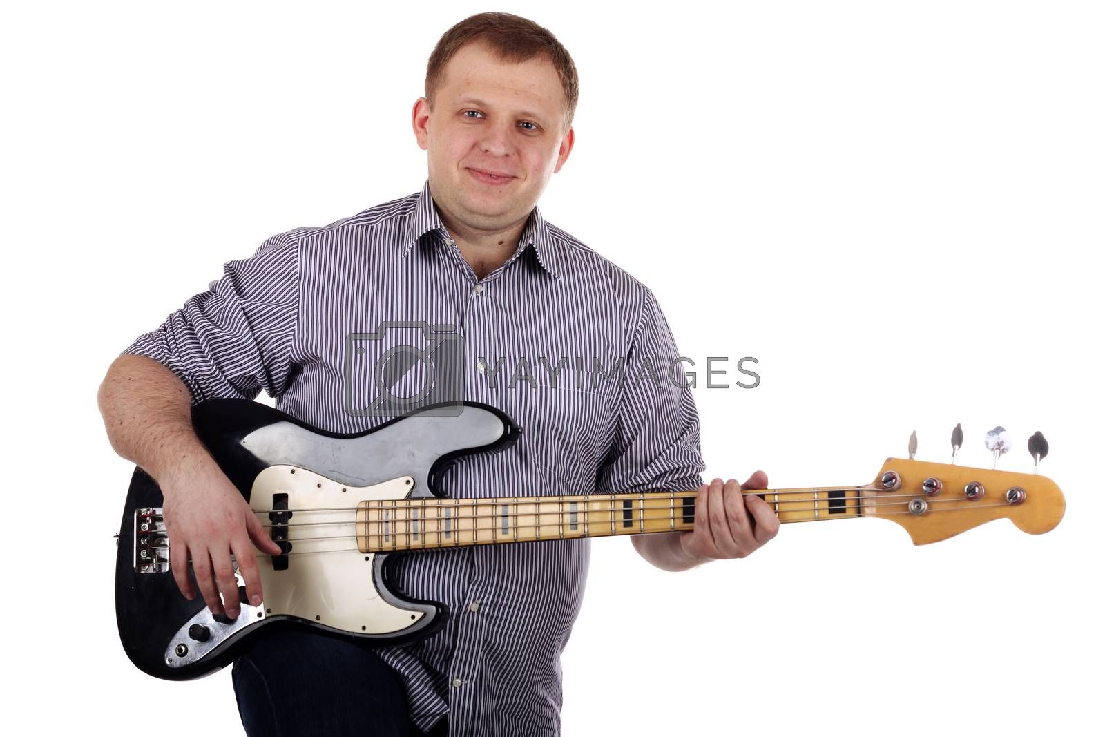 Young man playing guitar isolated on the white