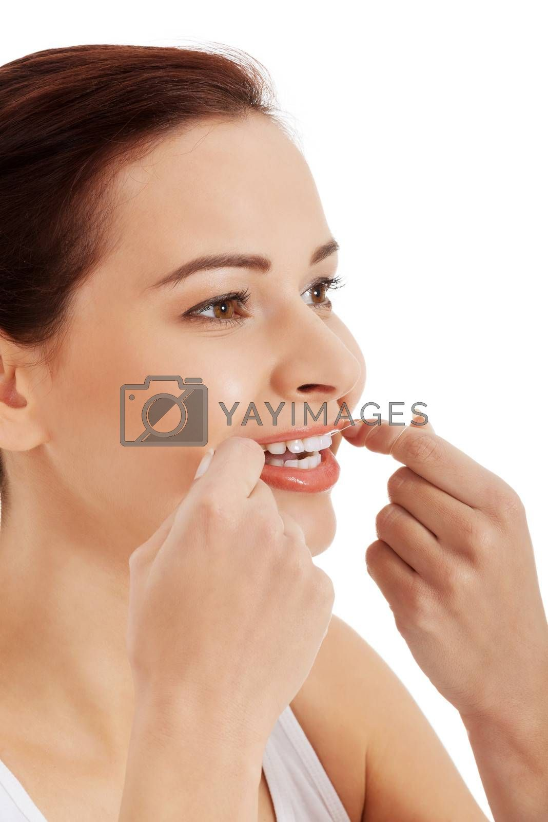 Beautiful young woman with dental floss. Isolated on white.