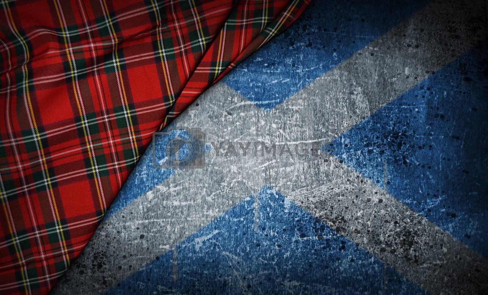 tartan textile on stone background with scotland flag