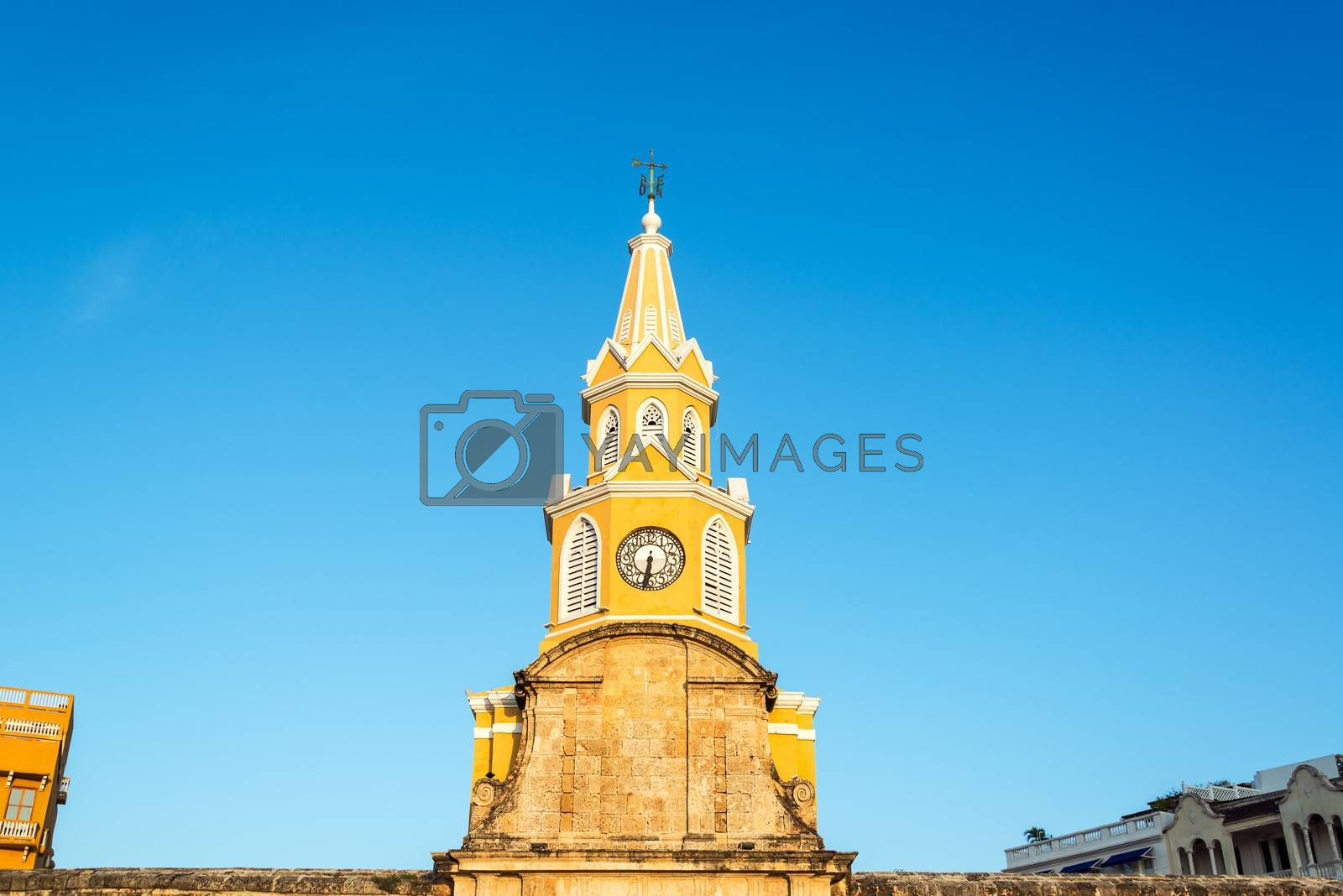 The yellow clock tower marking the entrance to the old town of Cartagena, Colombia