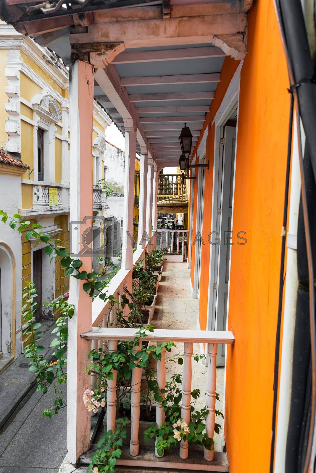 View of orange and white colonial balcony in the historic city of Cartagena, Colombia