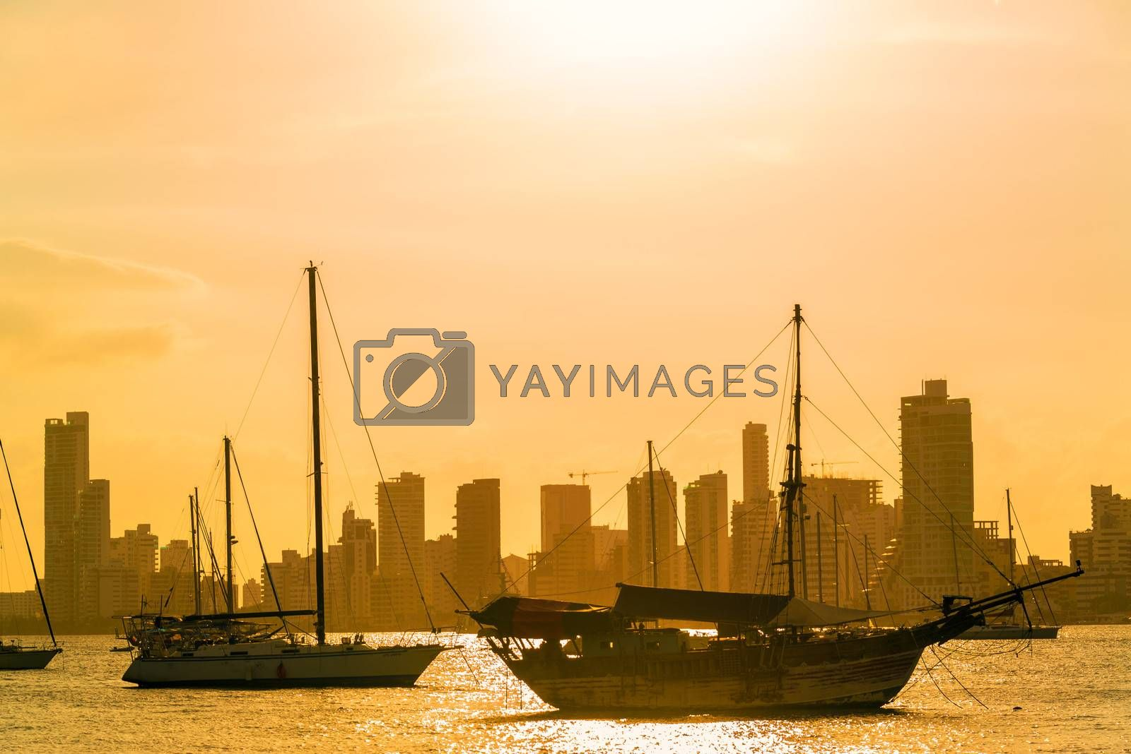 Boats and skyscrapers at sunset in Cartagena, Colombia