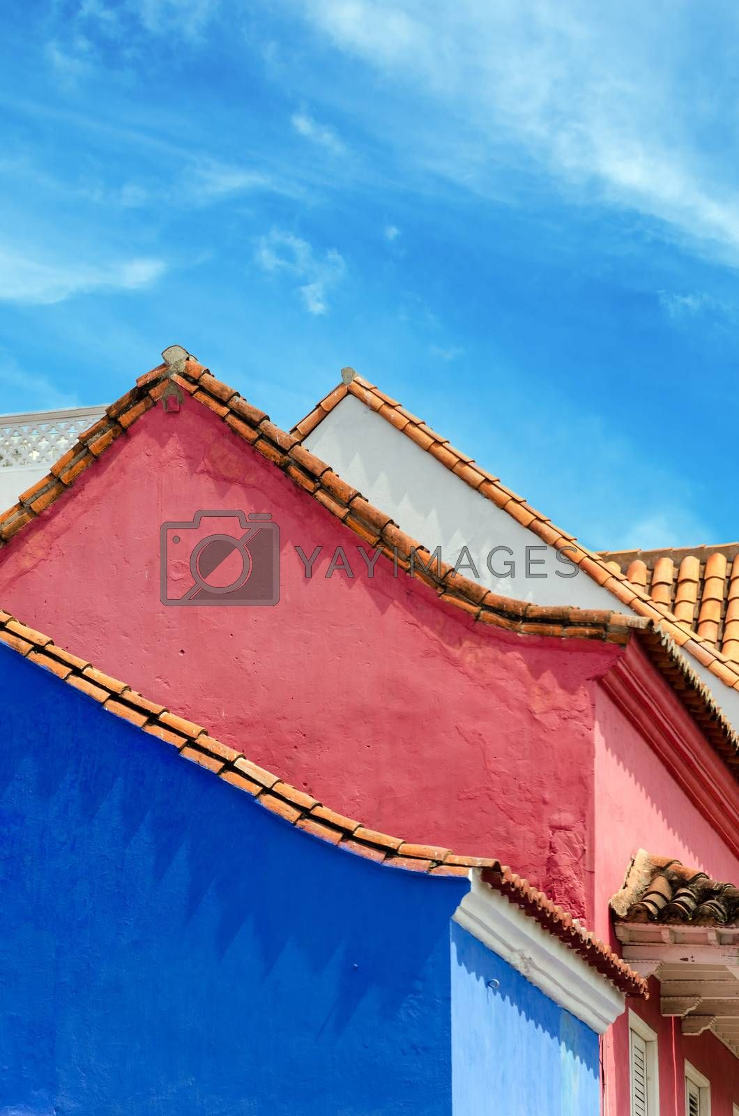 Blue, pink, and white colonial buildings in the old town of Cartagena, Colombia