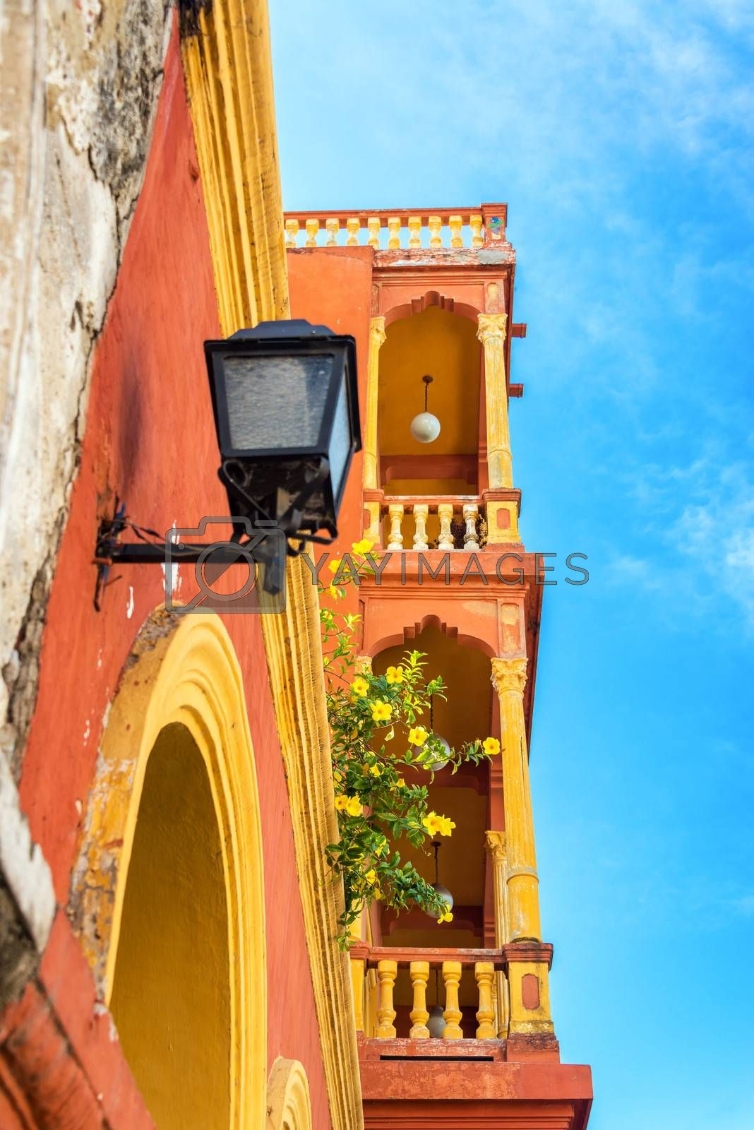 Orange and yellow balconies in the neighborhood of Getsemani in the historic city of Cartagena, Colombia