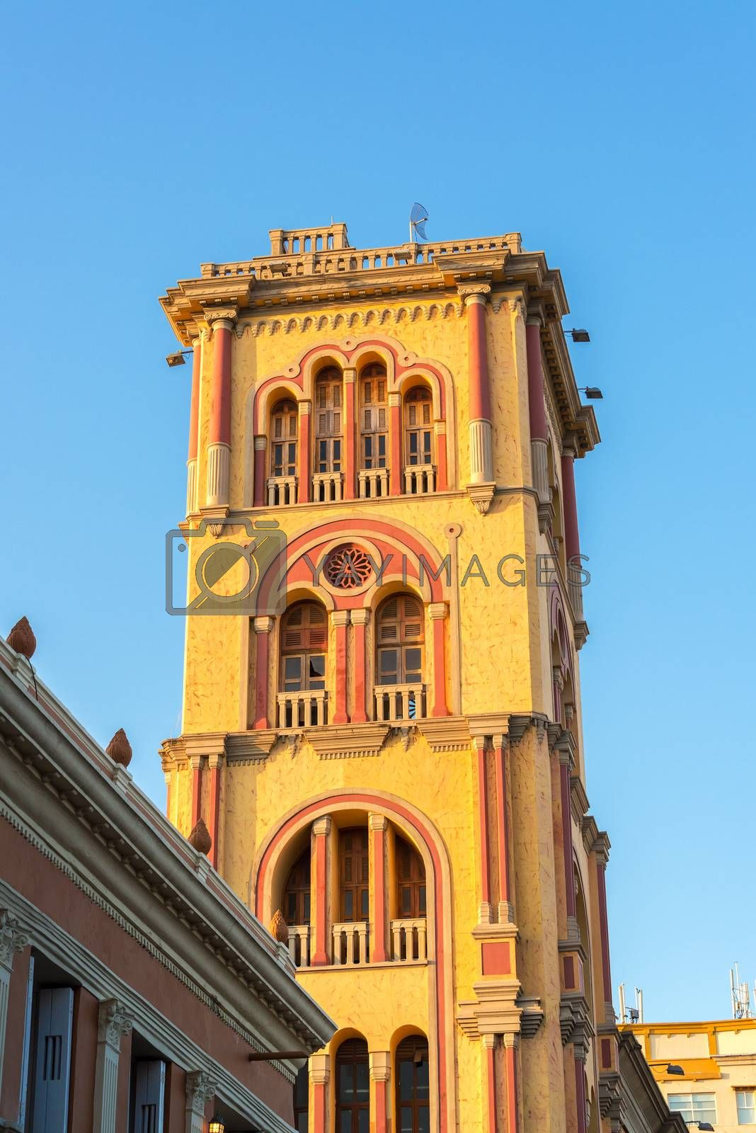 Tower of Cartagena Public University bathed in golden late afternoon light in Cartagena, Colombia