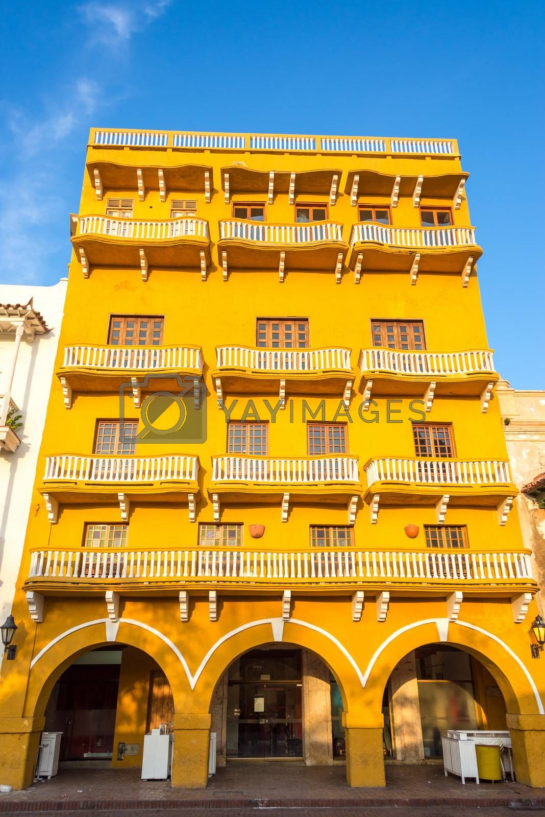 Historic architecture of a yellow colonial building in the historic center of Cartagena, Colombia