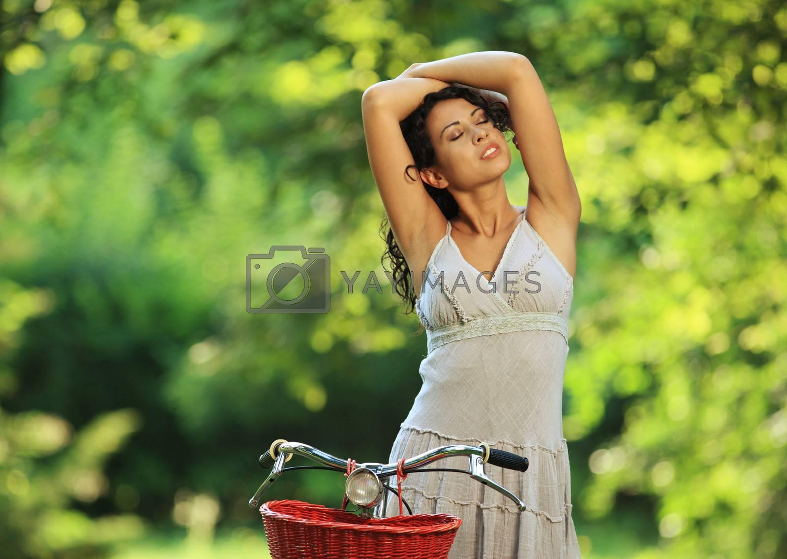 Sensual woman enjoying the fresh air at the park