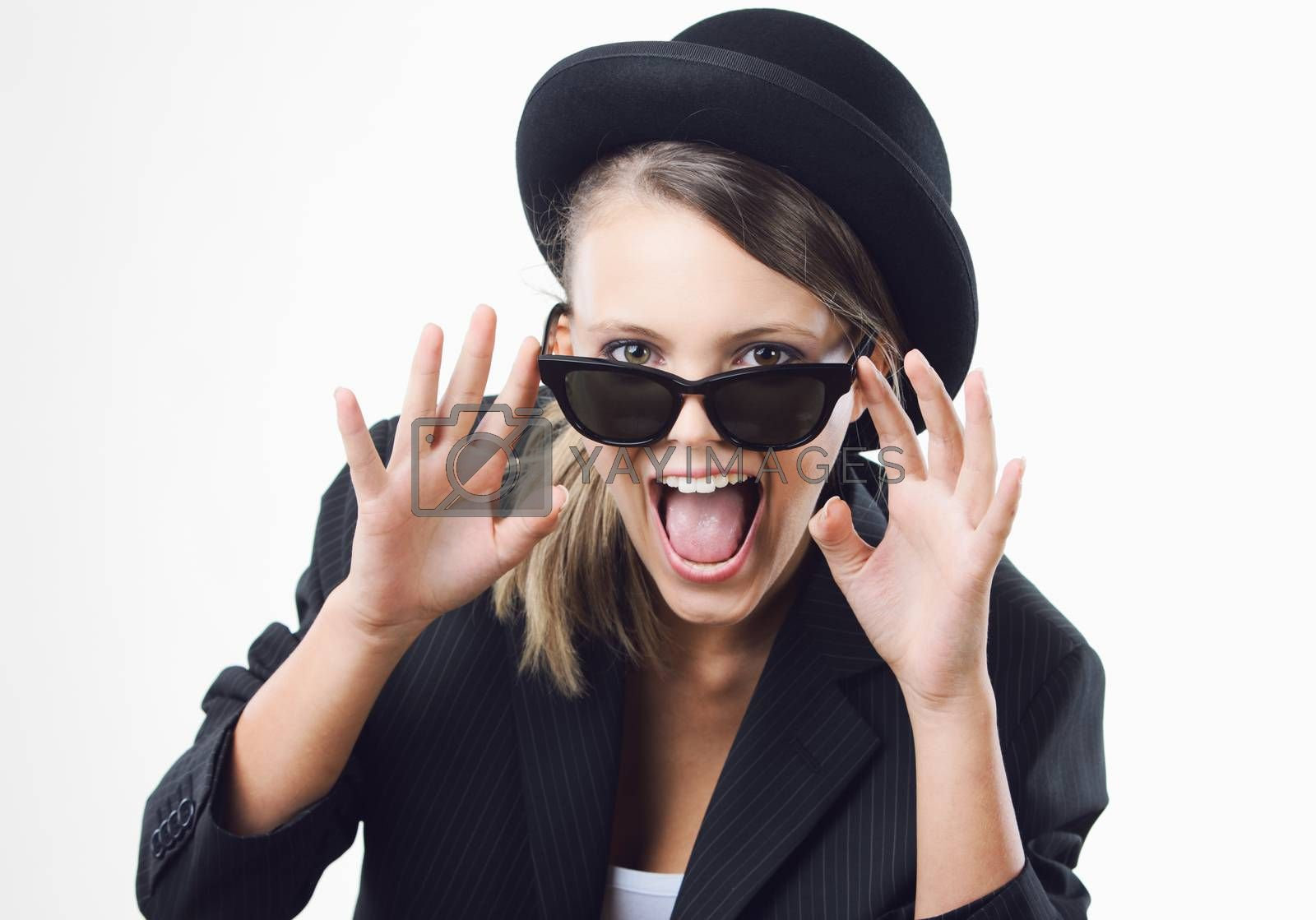Excited blonde girl wearing sunglasses on white background