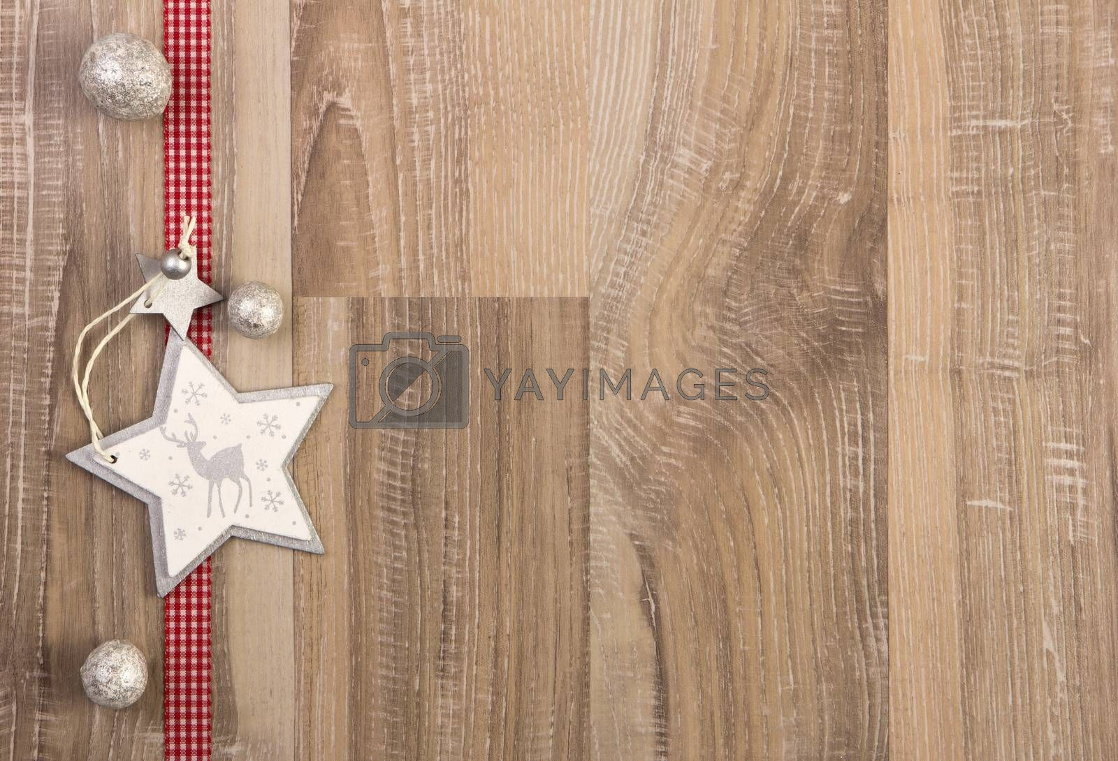 moravian star white with red ribbon on wooden background