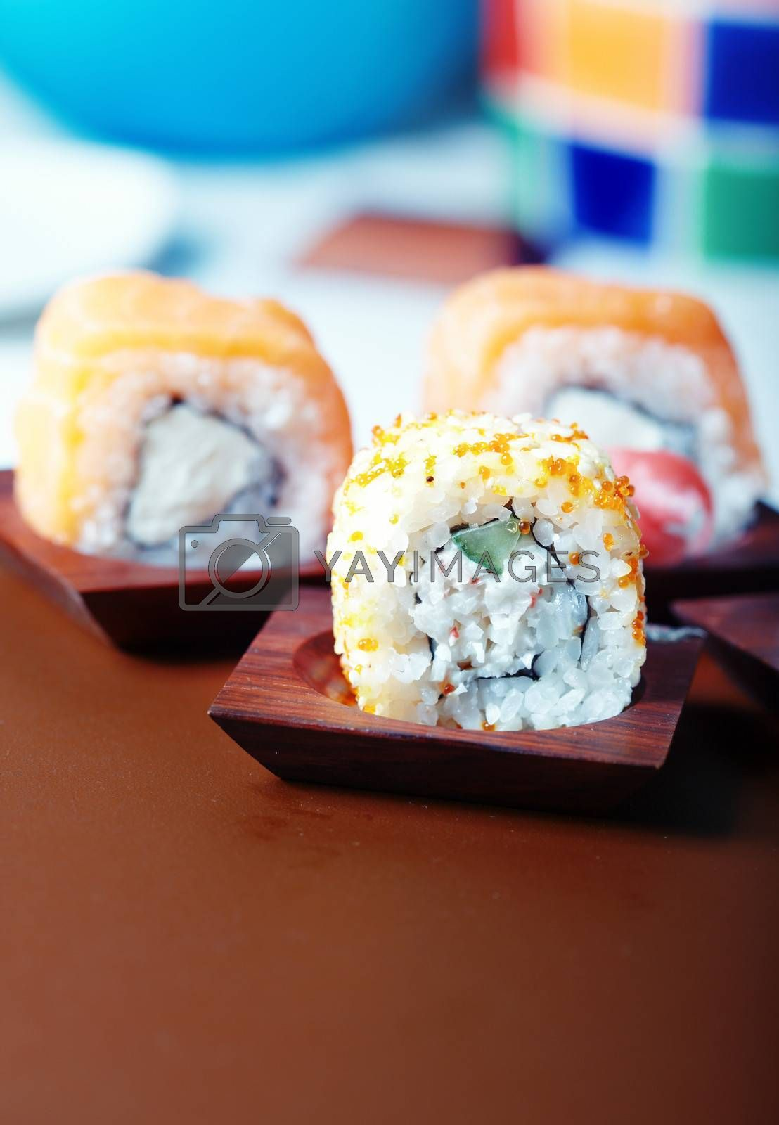 Sushi on the table. Vertical photo with natural colors. Shallow depth of field added for natural view