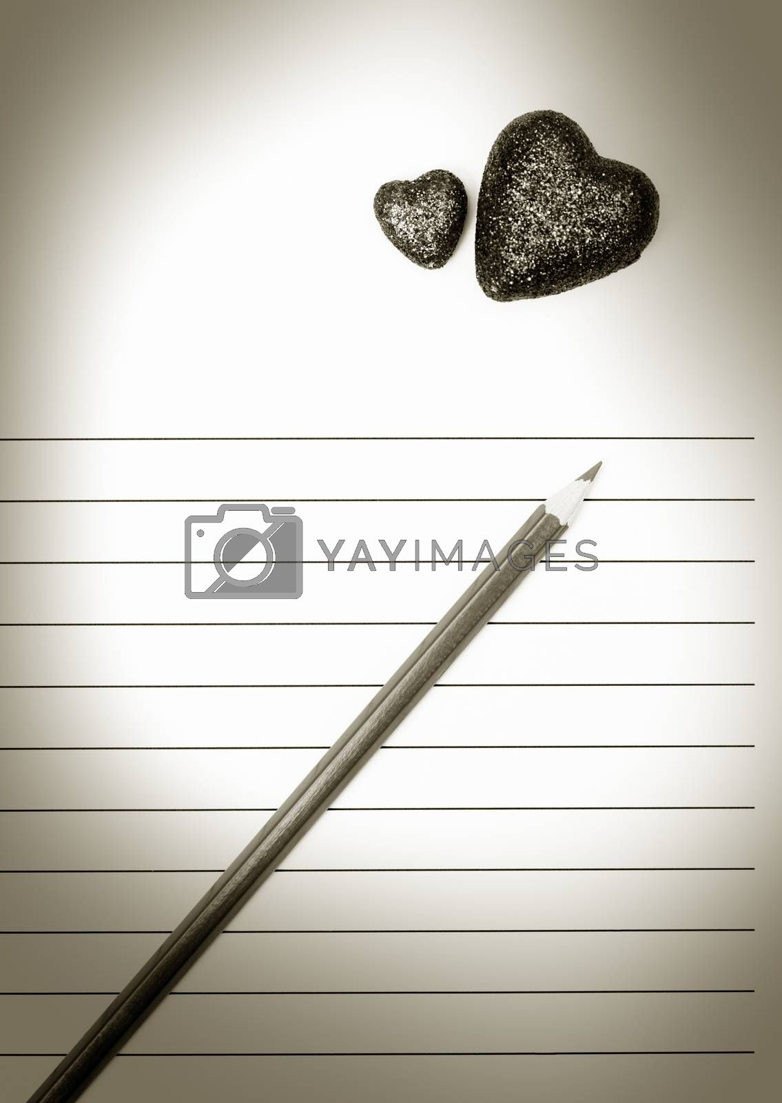 Pencil and two hearts on a blank love letter. Sepia colors added