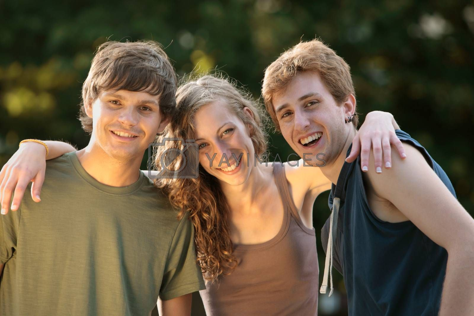 Young group of teenager friends smiling at camera
