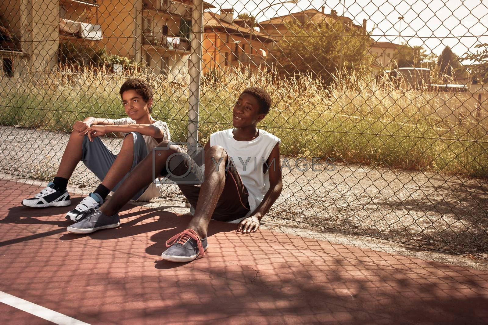 Two young African boy resting outdoors