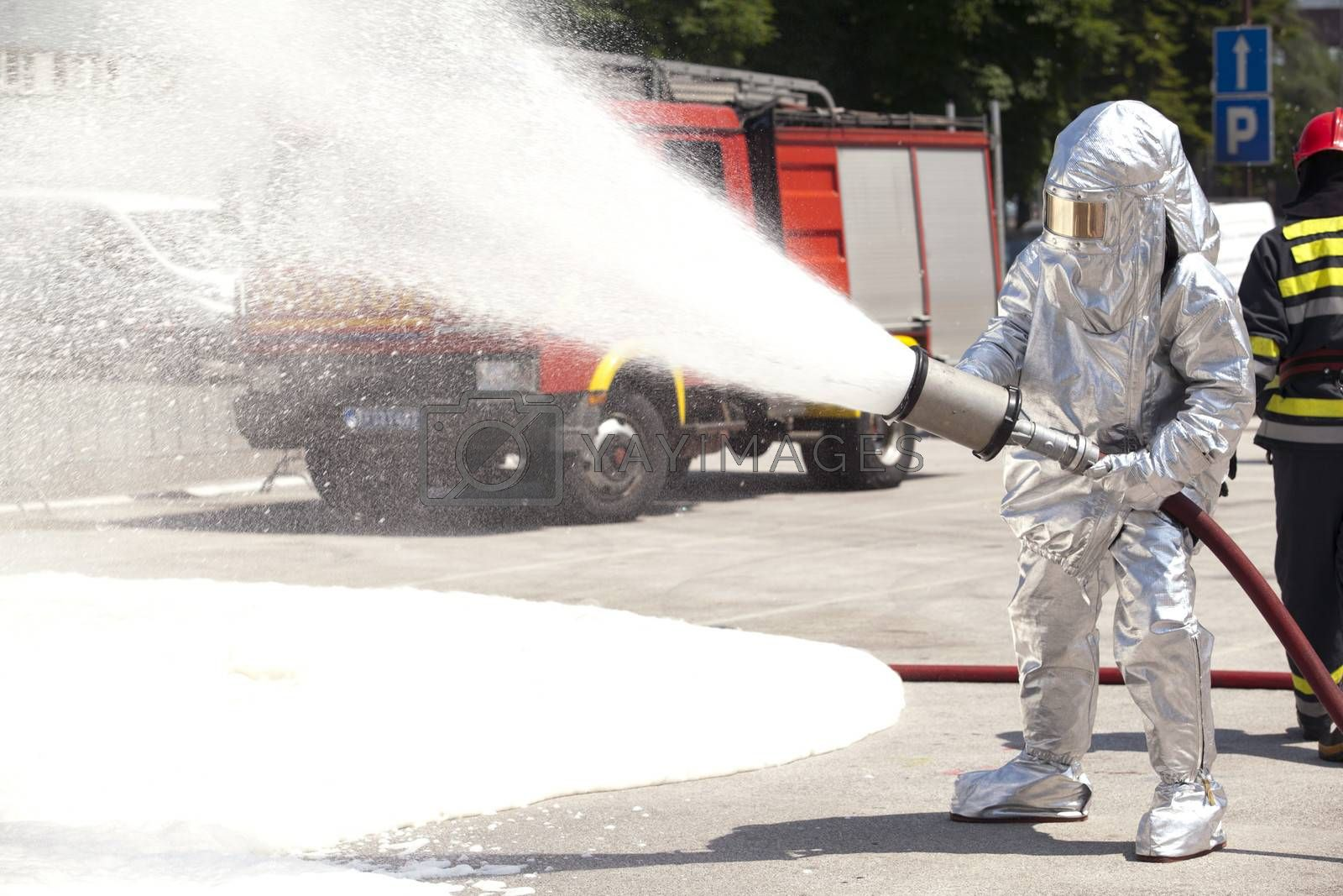 Royalty free image of Firefighter in action by wellphoto