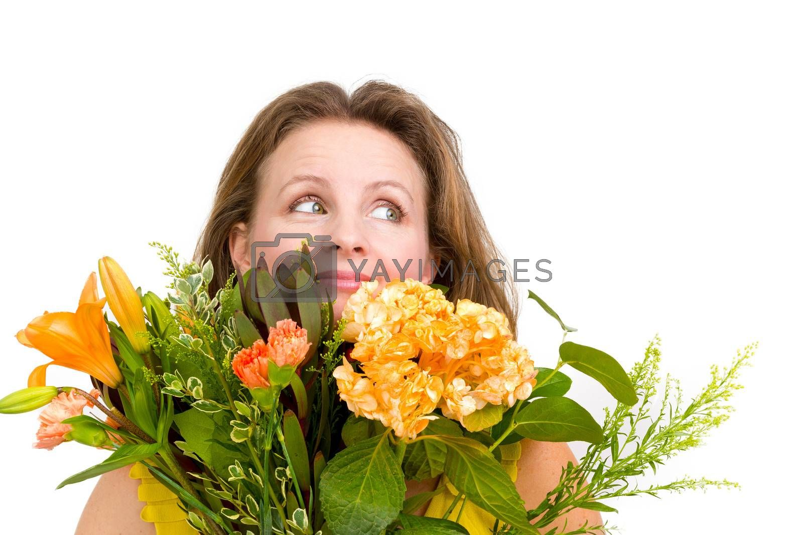 Happy woman looking up behind the flower  bouquet expressing her positive feelings genuinely