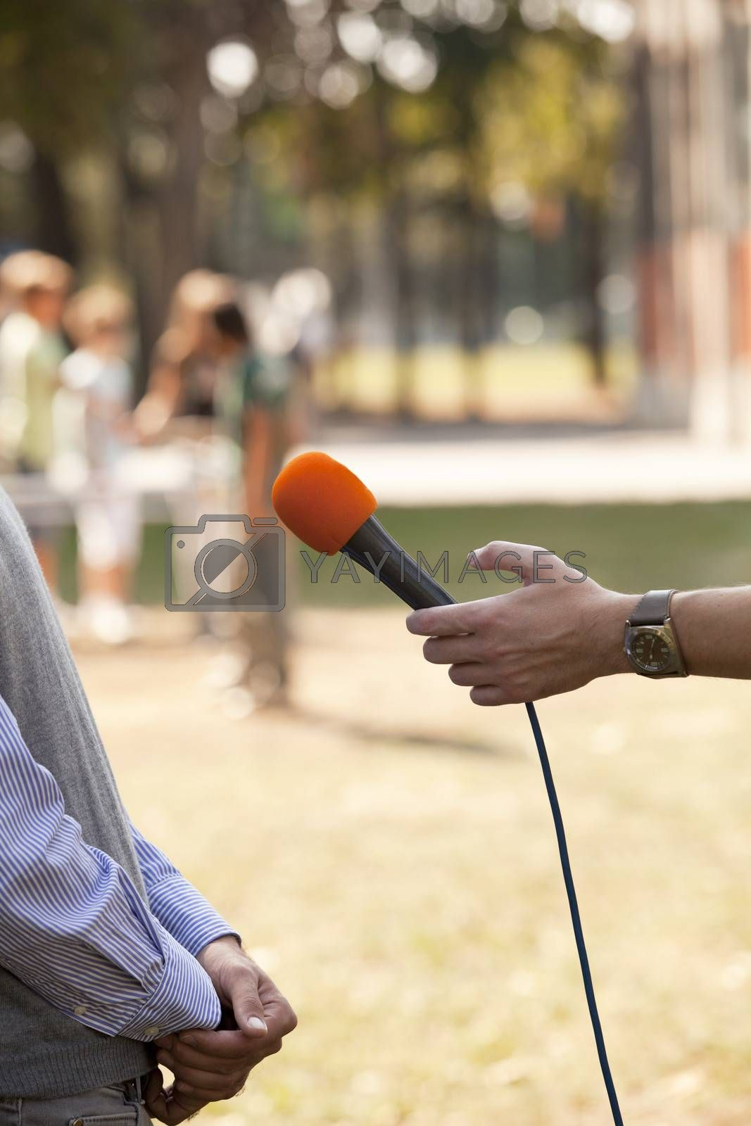 Royalty free image of Media interview by wellphoto