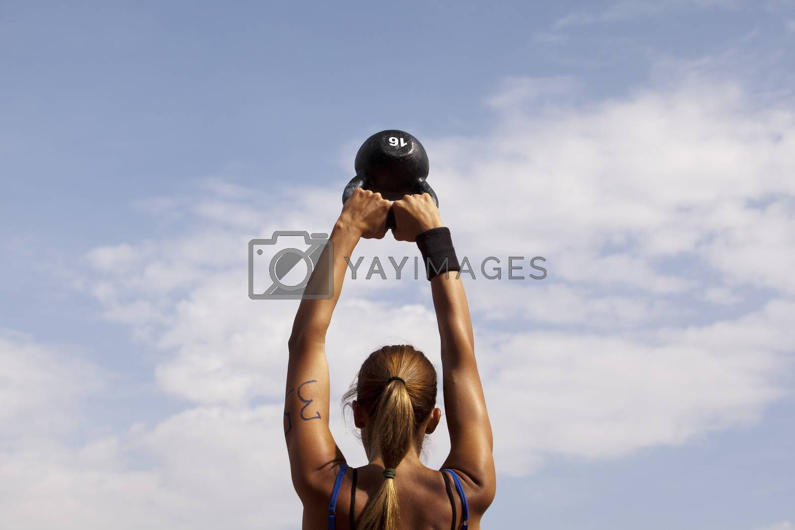 Royalty free image of Crossfit kettlebell swing by wellphoto