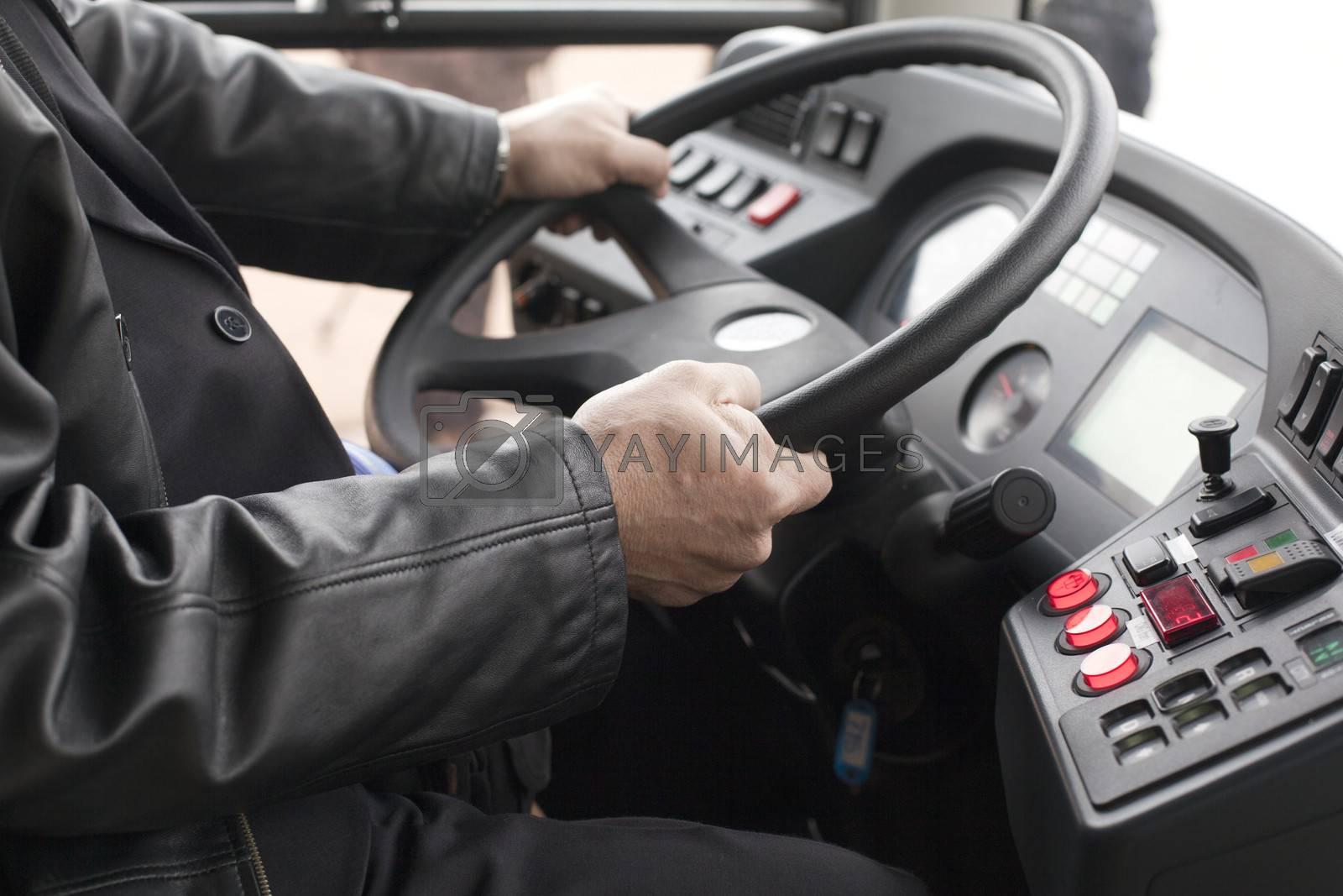 Man driving a bus