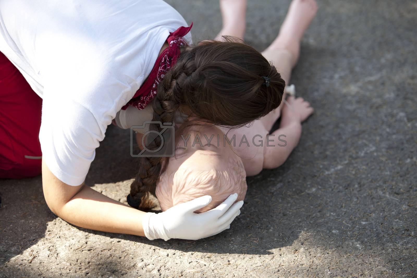CPR practitioner examining airways on dummy