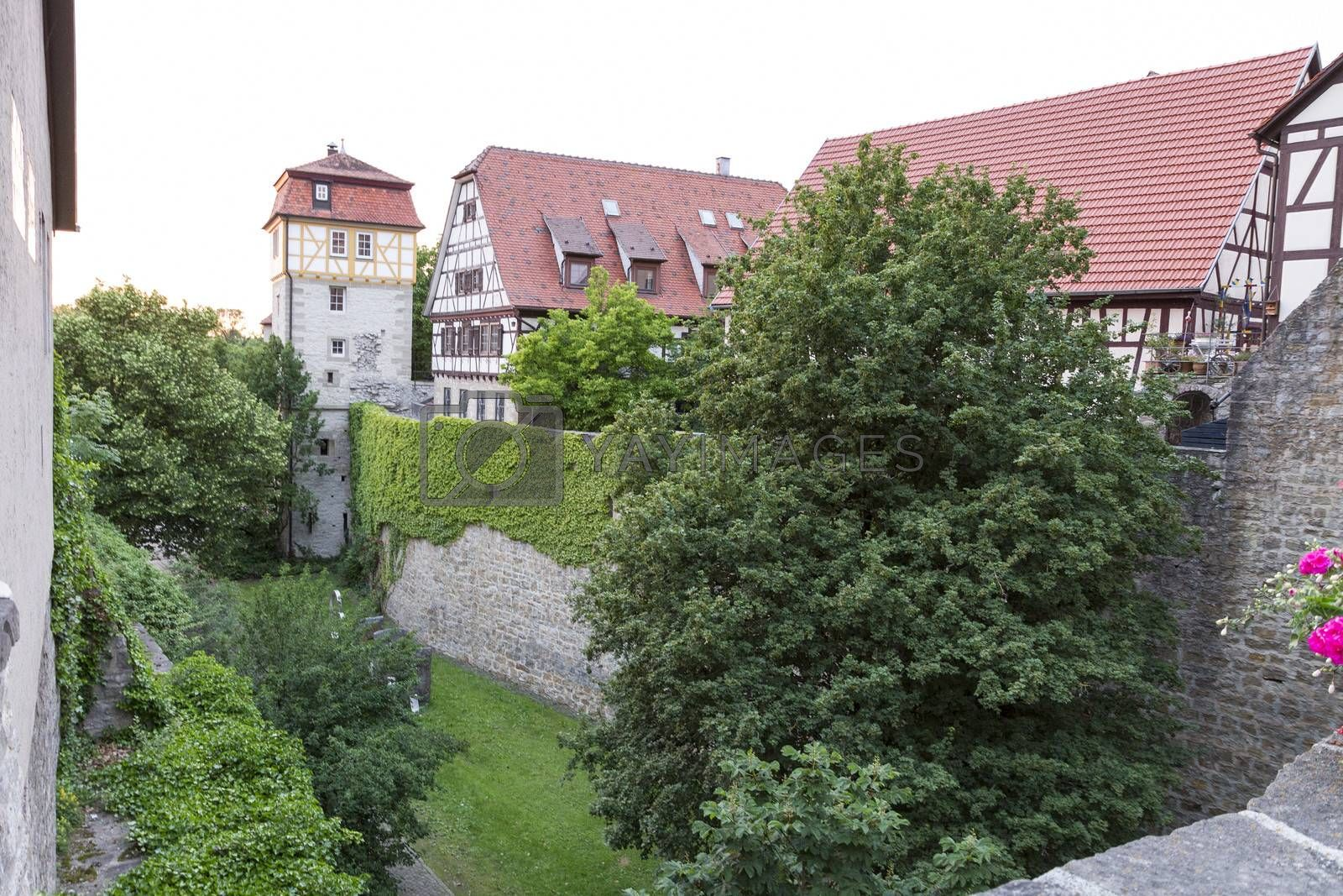 medieval buildings with half-timbered houses and moat