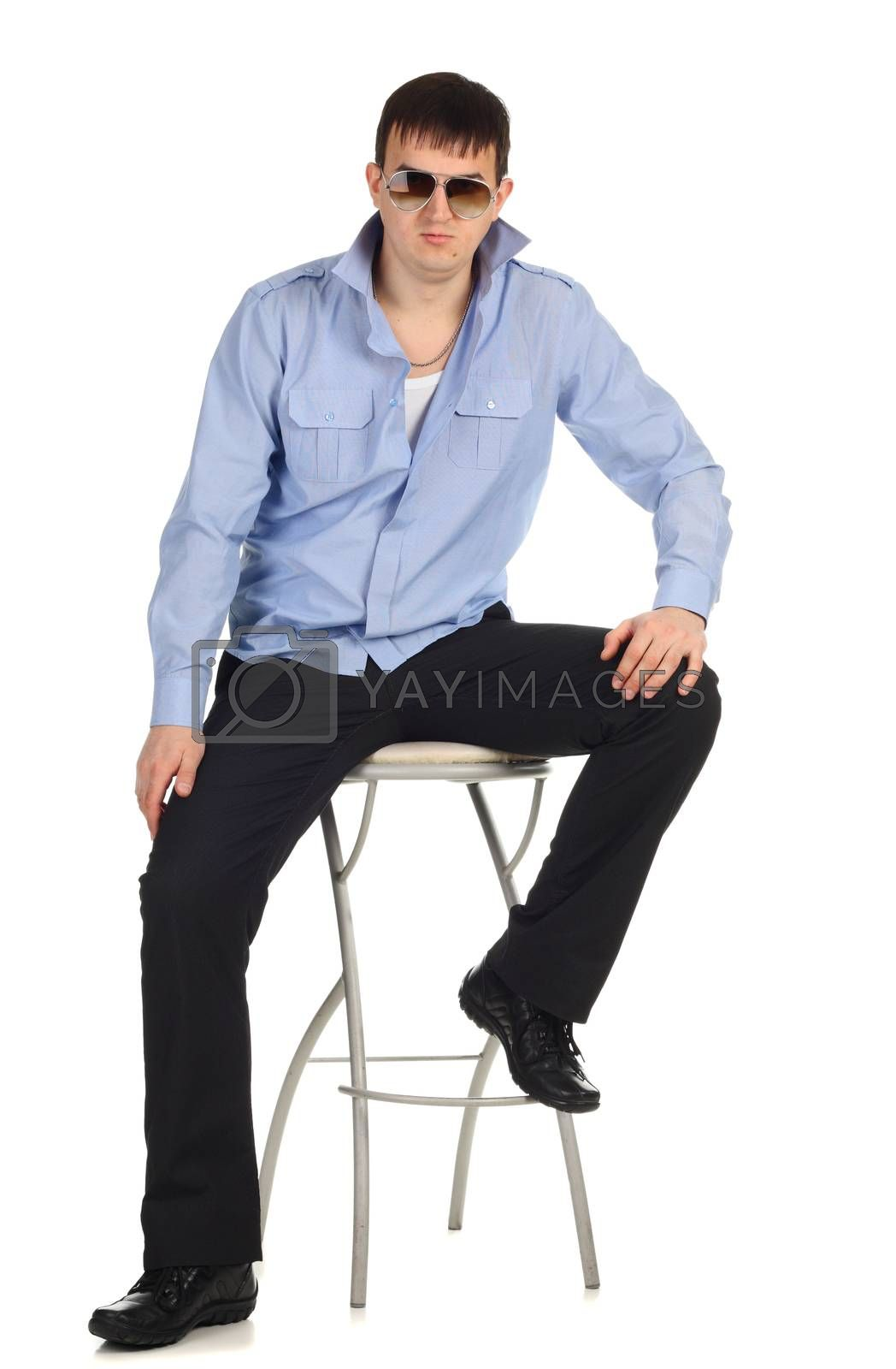 Funny guy sitting on the chair isolated on the white