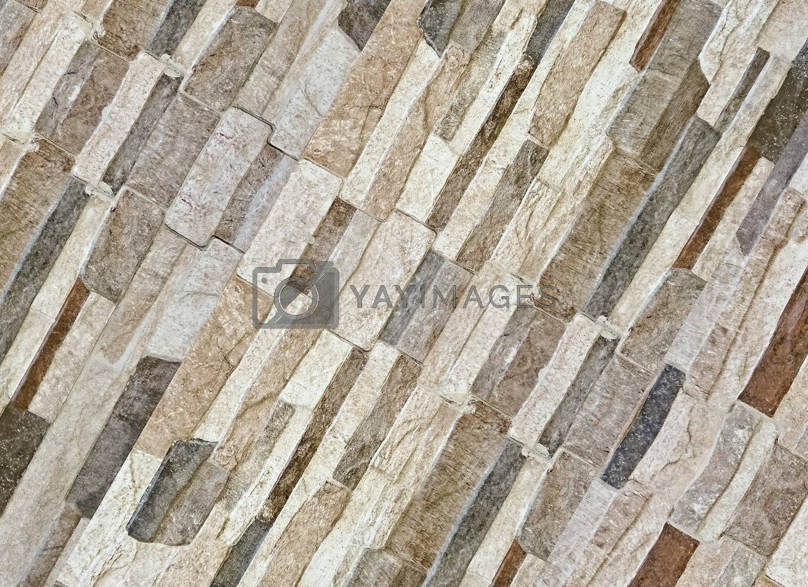 Real house stone wall pattern in multicolored scheme in diagonal composition useful as background, material texture or pattern