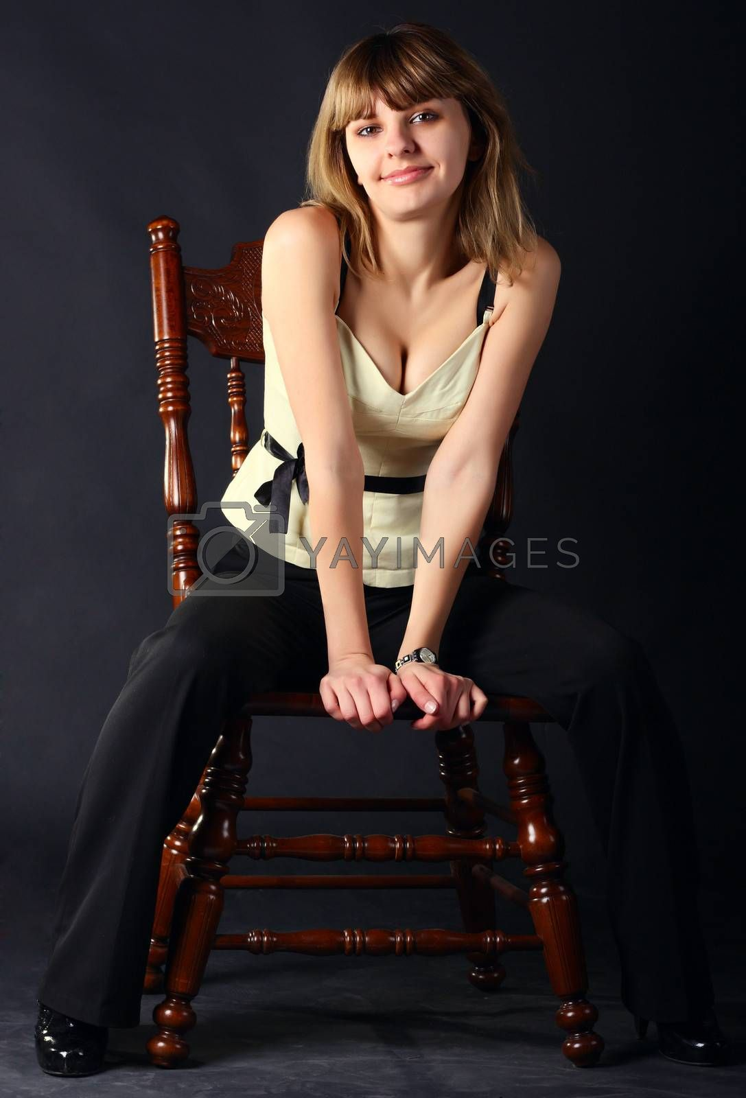 Young beautiful women sitting on a chair