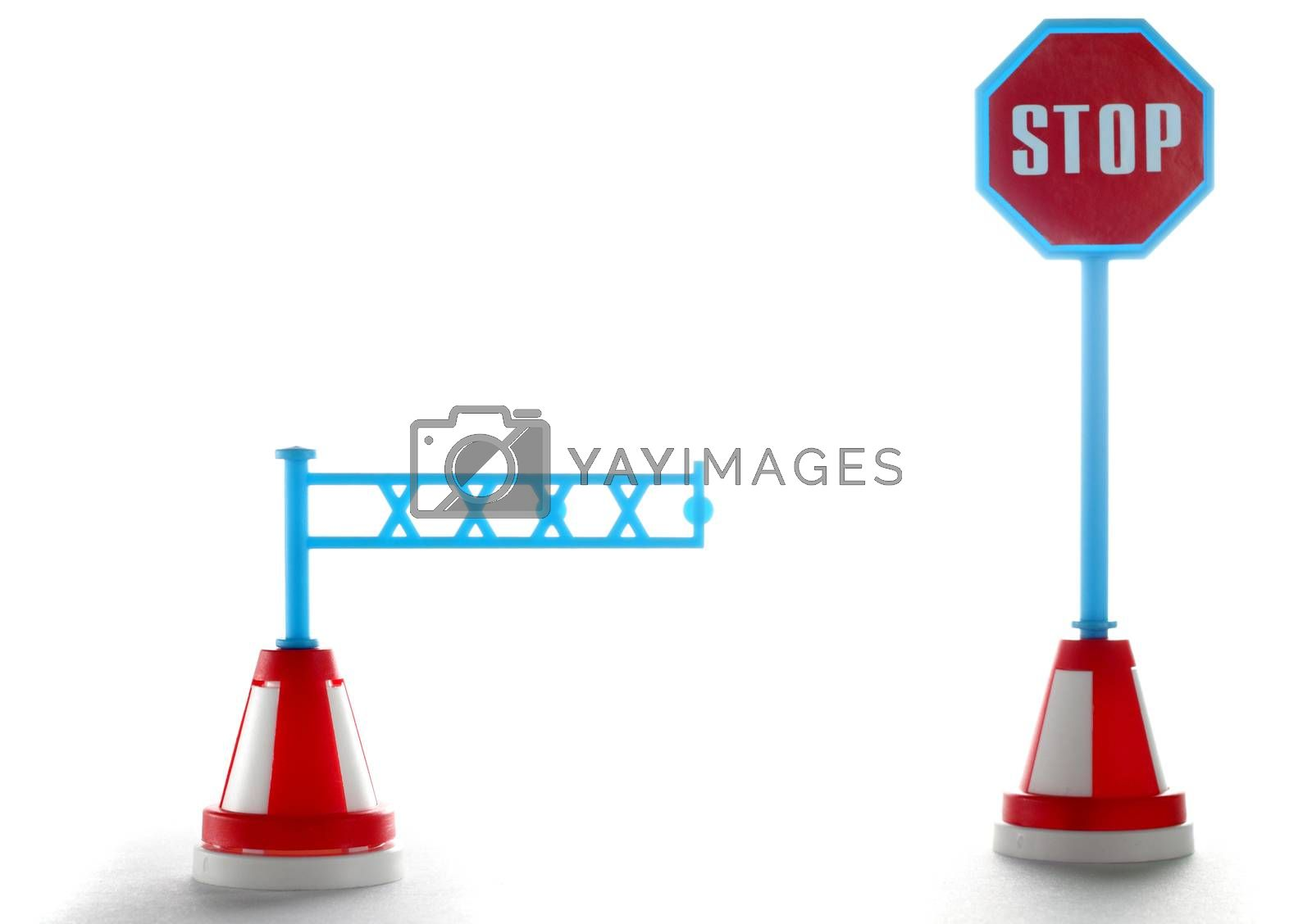 Barrier with stop road sign isolated on a white