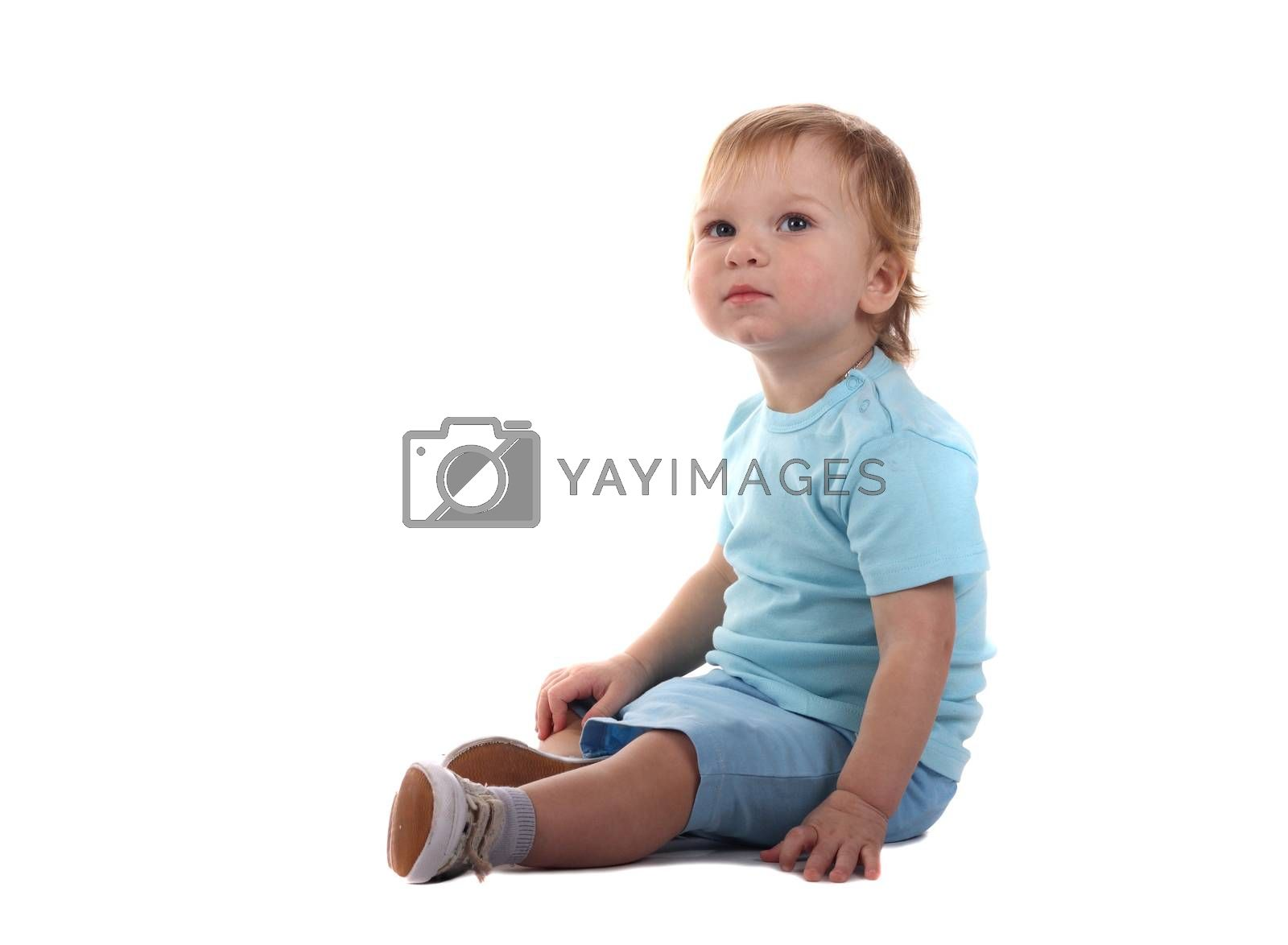 Little boy sitting isolated on the white