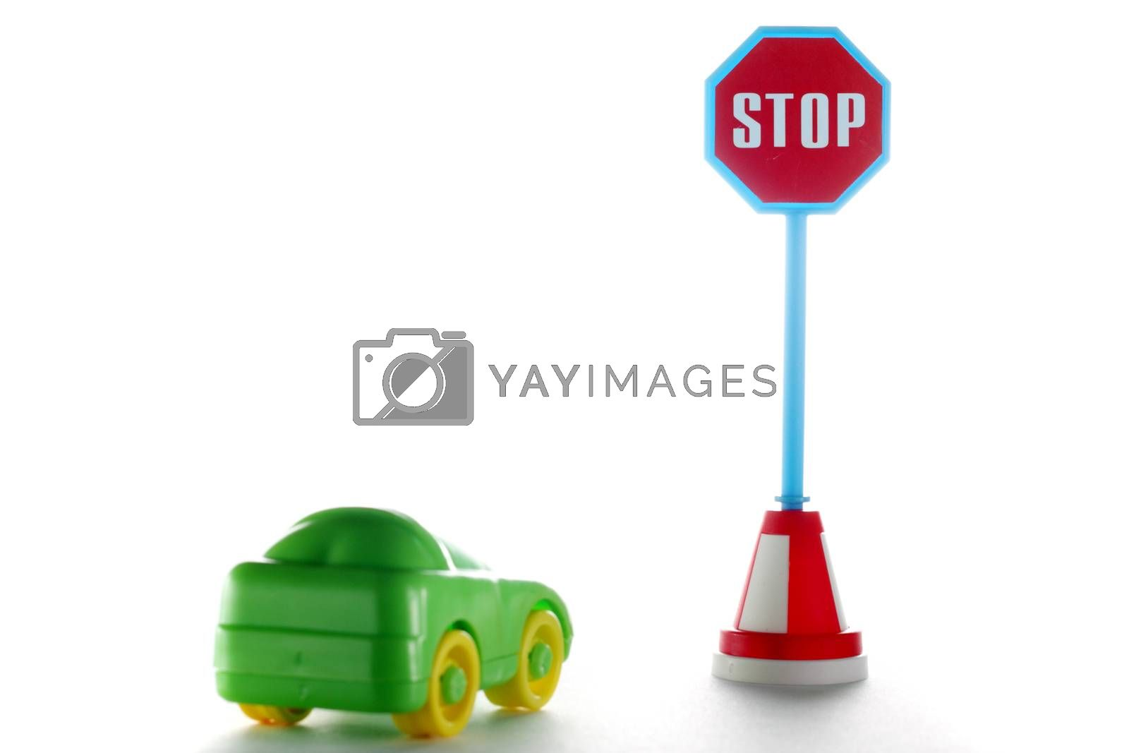 Car behind stop road sign on a white background