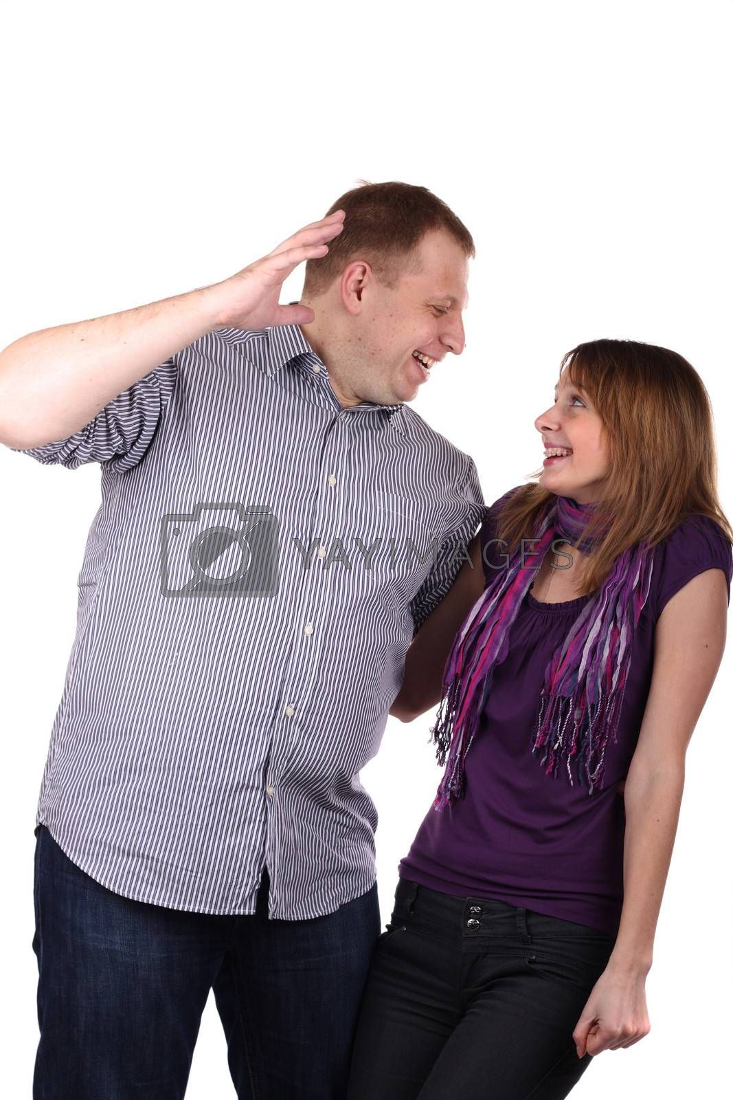 Young Lovely couple joking isolated on the white background