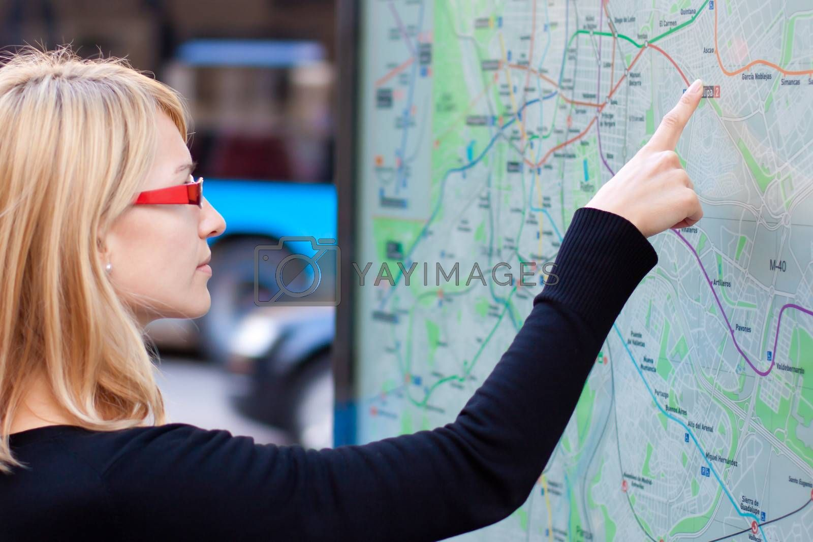 Woman looking on the metro map board by kasto