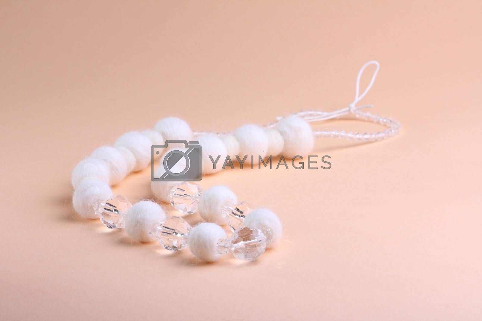 White beautiful beads at pink background