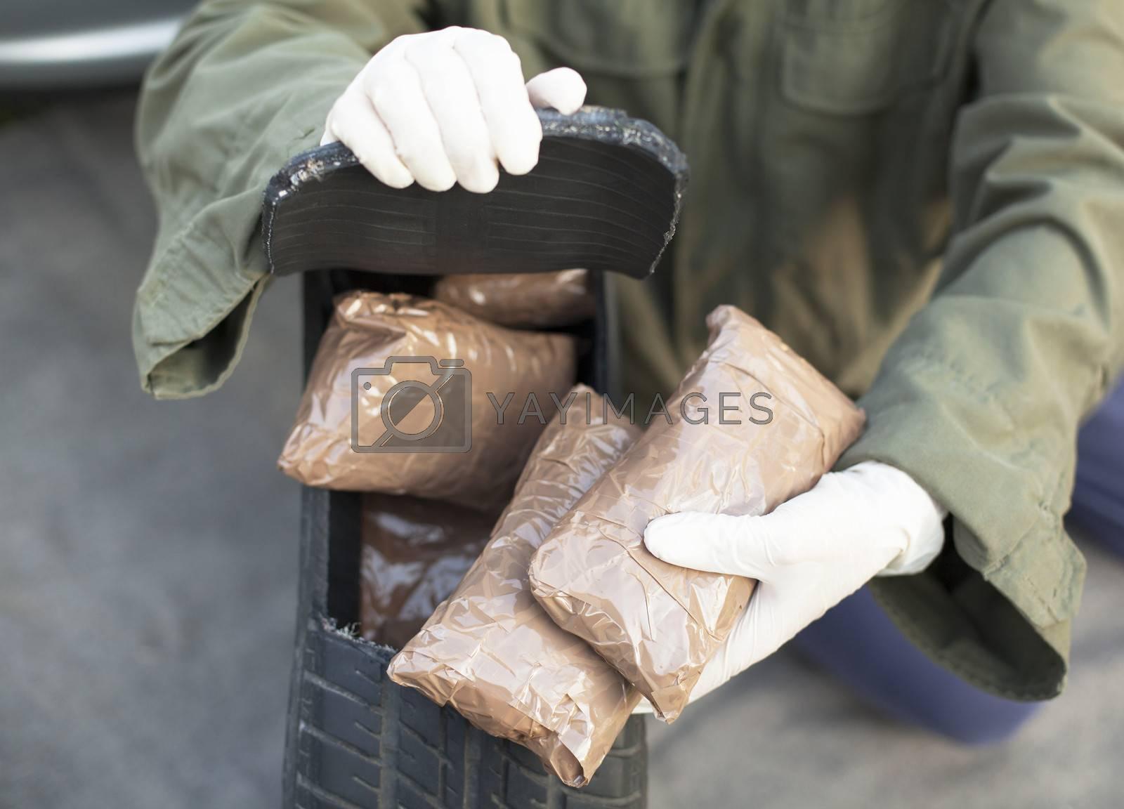 Drug bundles found in spare tire