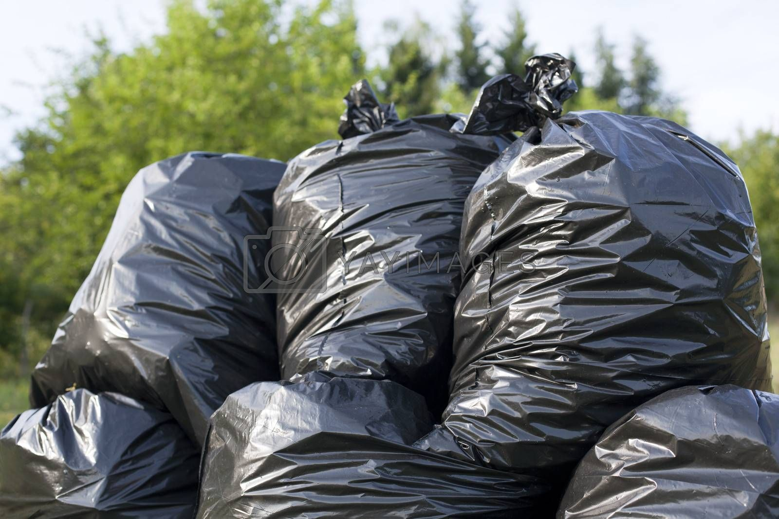 A pile of black garbage bags