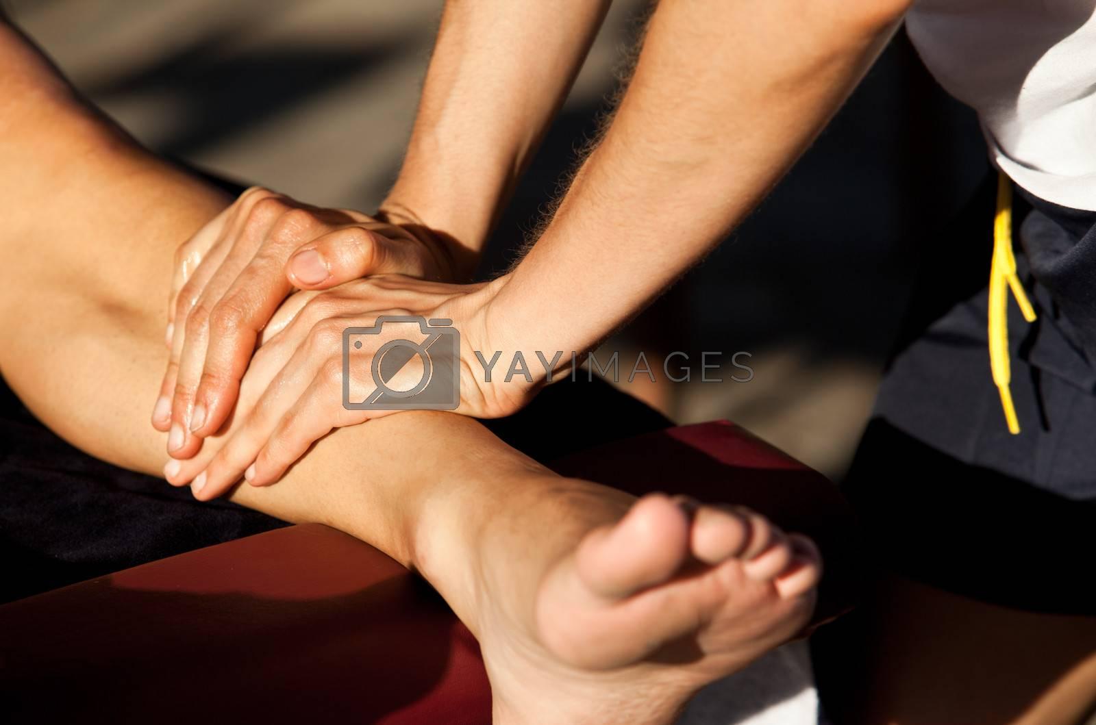Therapist giving a leg massage