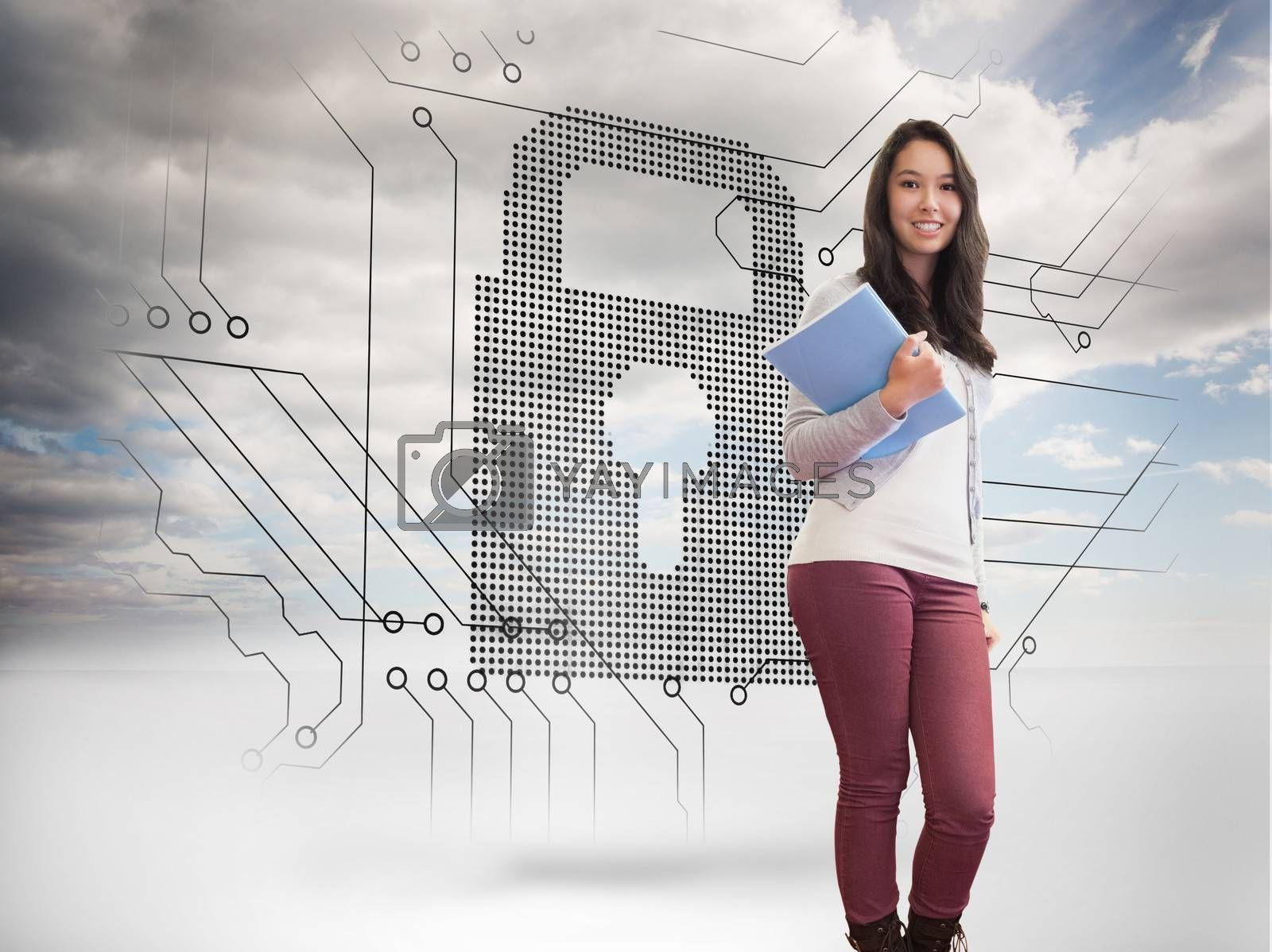 Composite image of student standing in a computer room and holding a folder while smiling