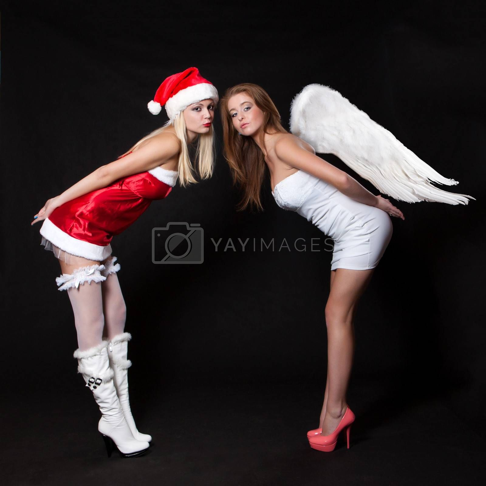 Girls sexy Santa Claus and angel with wings send a kiss