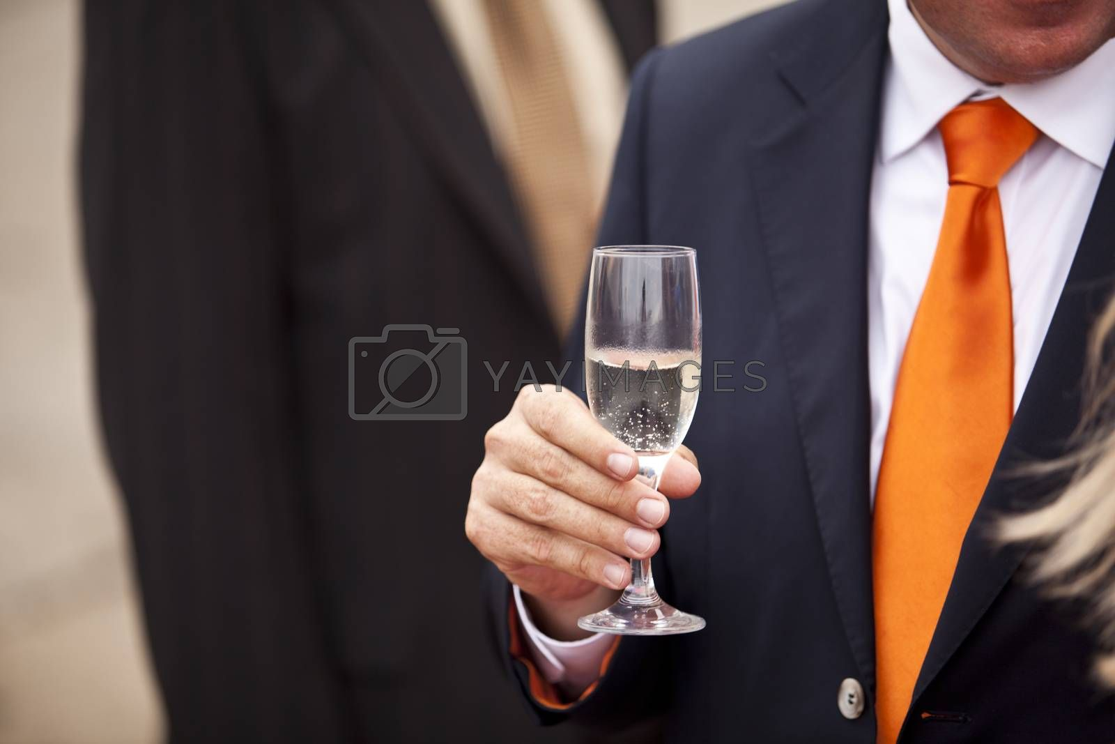 Businessman drinking champagne at a party