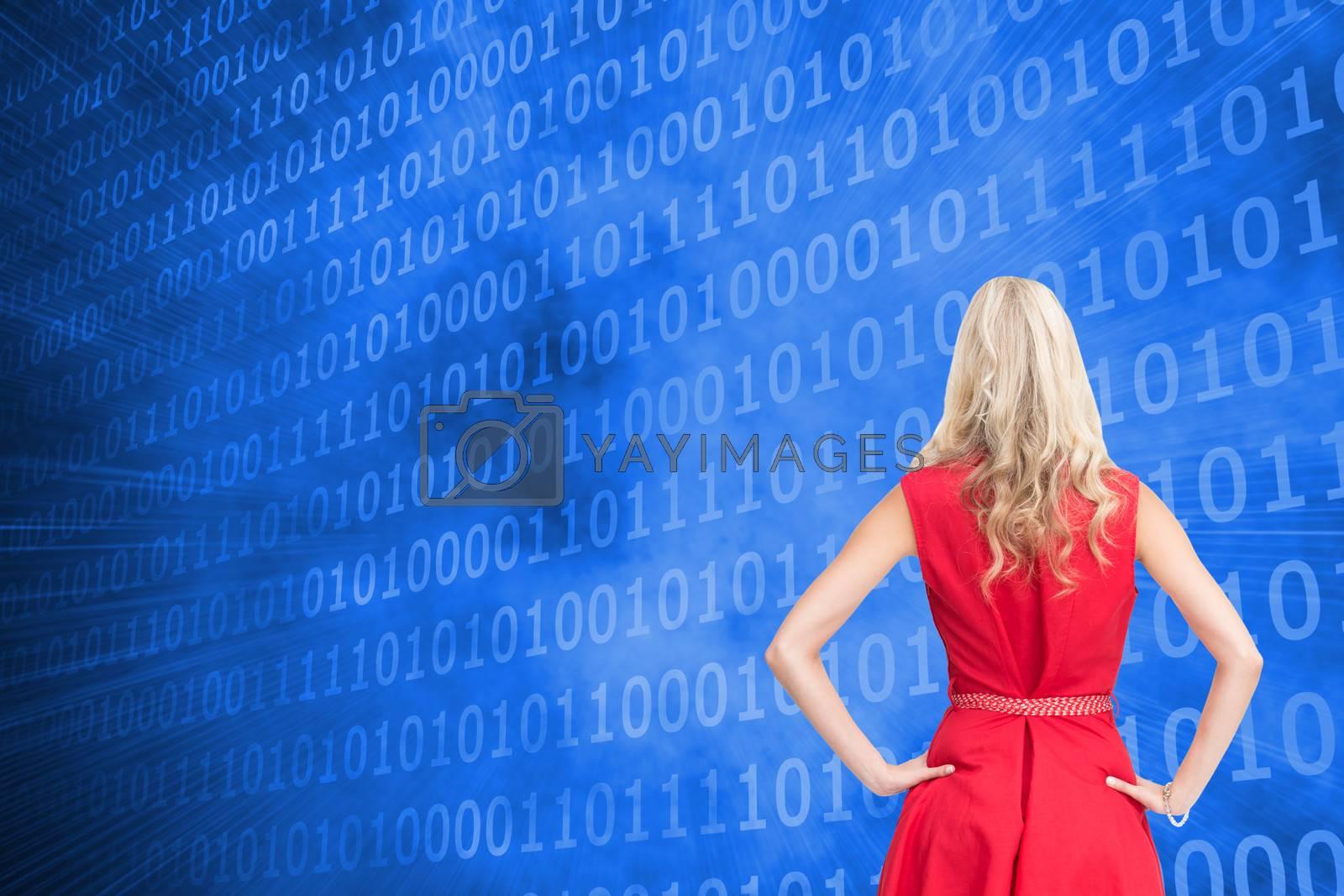 Composite image of elegant blonde standing hands on hips in red dress